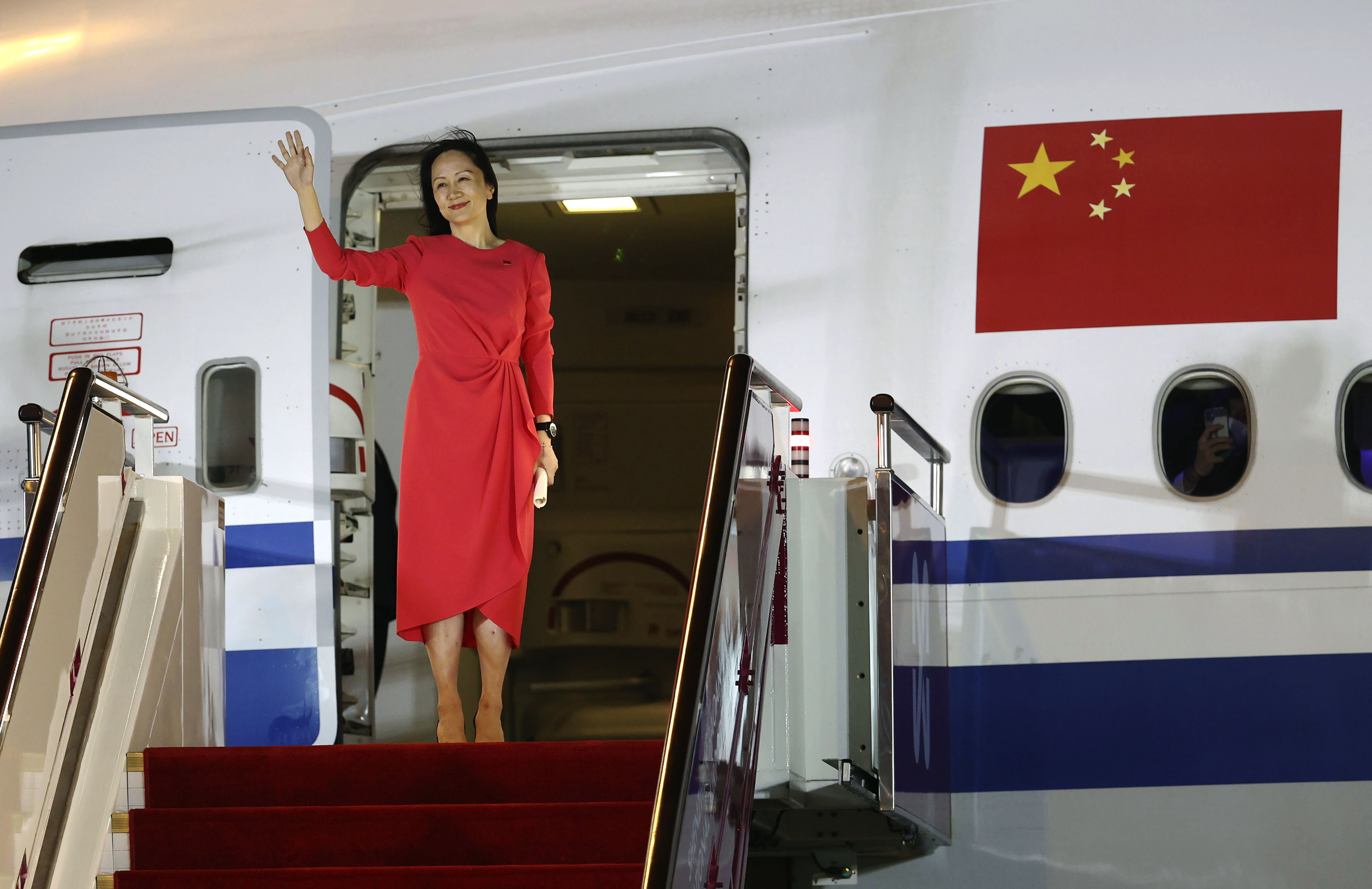 China celebrates Meng Wanzhou's return as a victory — even at the cost of its global image