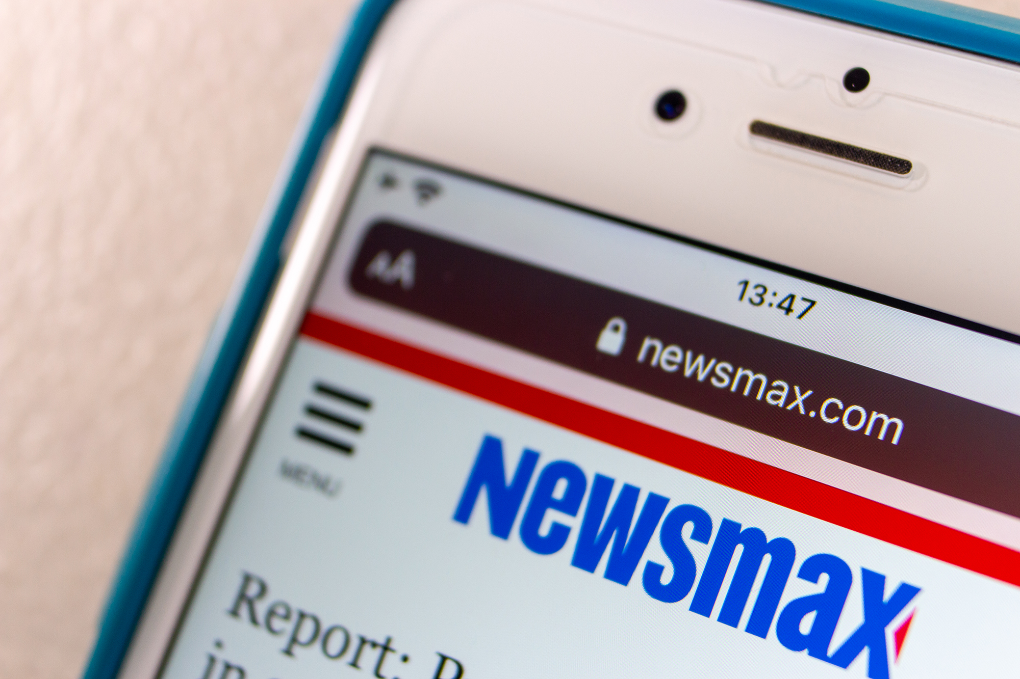 Newsmax portrays Facebook as an enemy of conservatives. Behind the scenes, it's spending millions on Facebook ads
