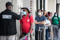 Security guards risk their lives by asking customers to wear masks