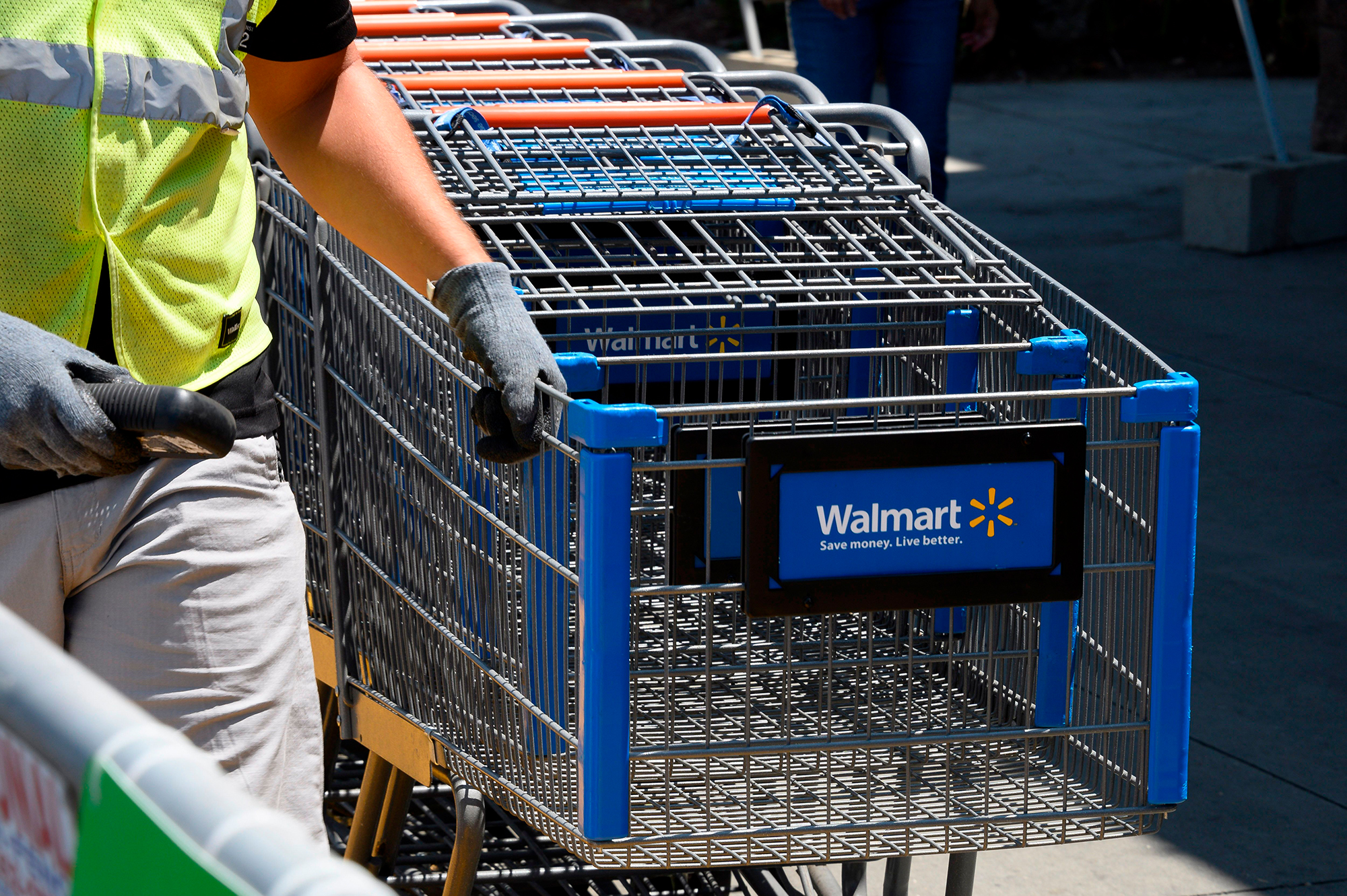 Walmart is paying its workers $388 million in holiday bonuses. Critics say it's not nearly enough