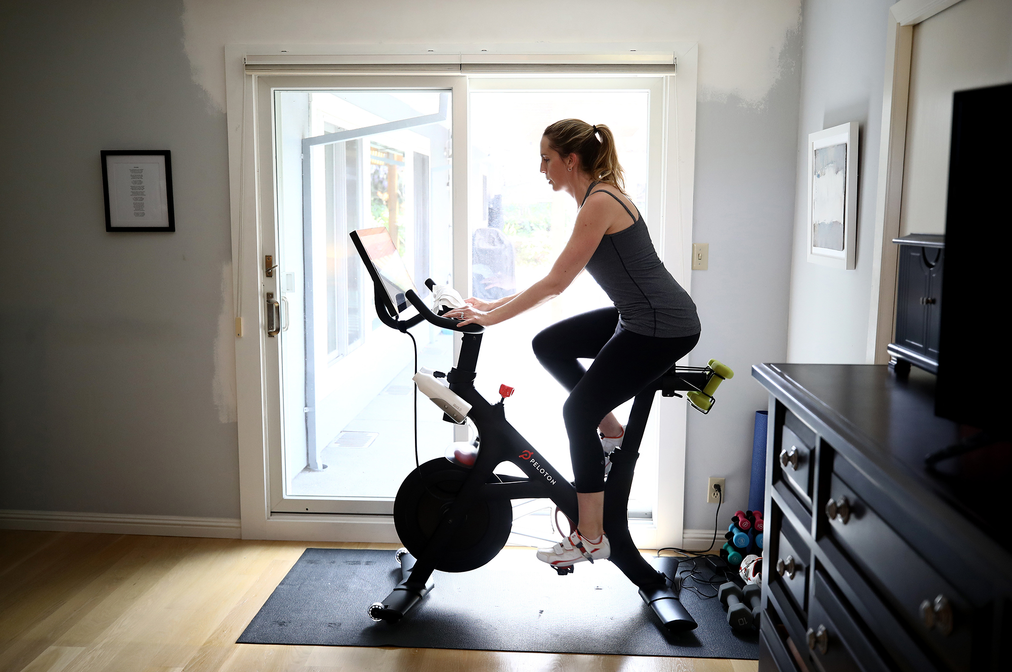 Peloton shares slip, then recover, after report of possible new competition from Apple