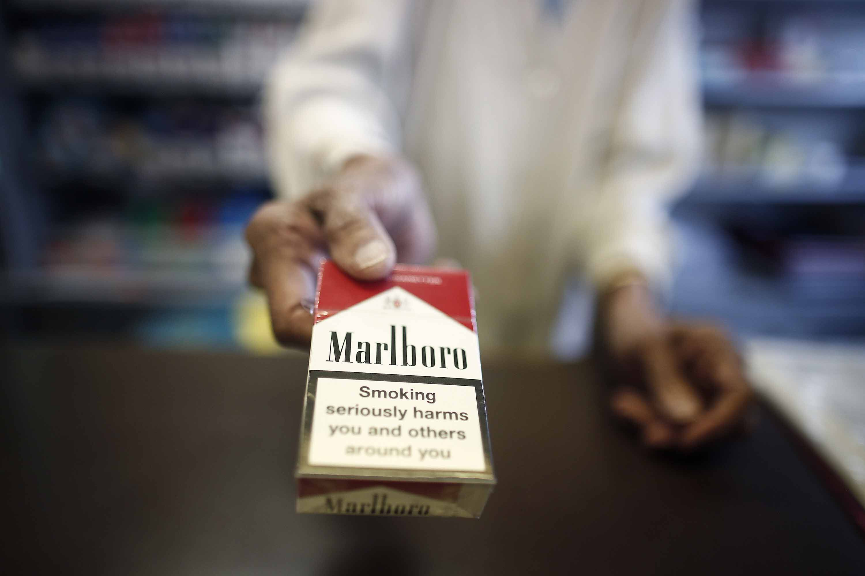 Marlboro owner wants to buy a company that makes asthma inhalers. Health charities say it must be stopped