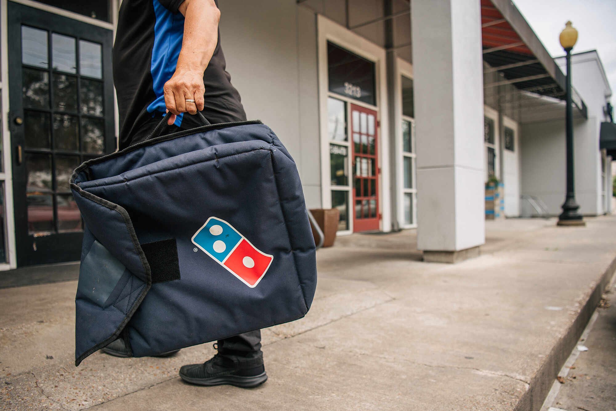 Domino's is giving away $50 million of free food to take on DoorDash