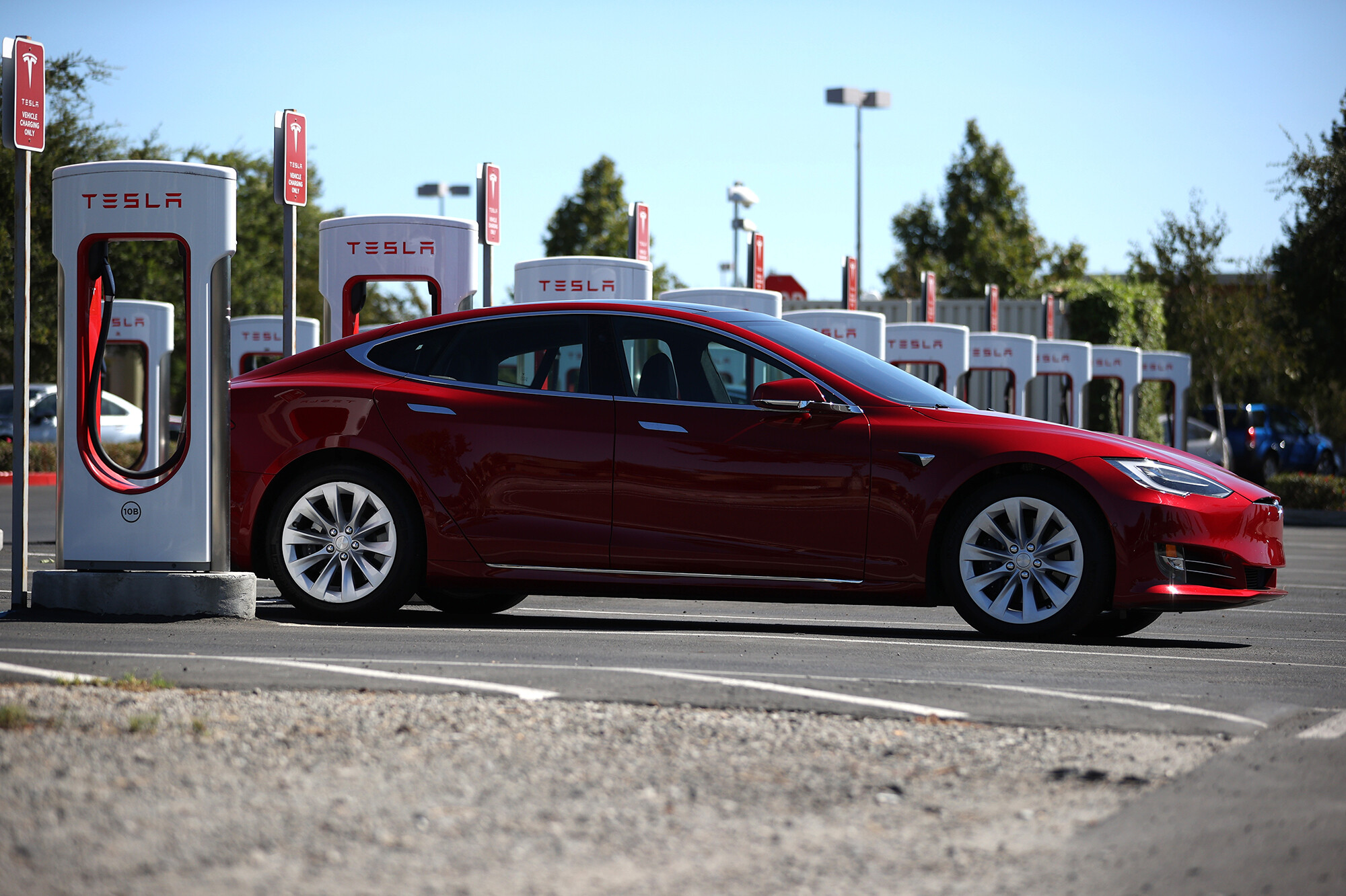The Dow and S&P 500 hit record highs as Tesla stock electrifies