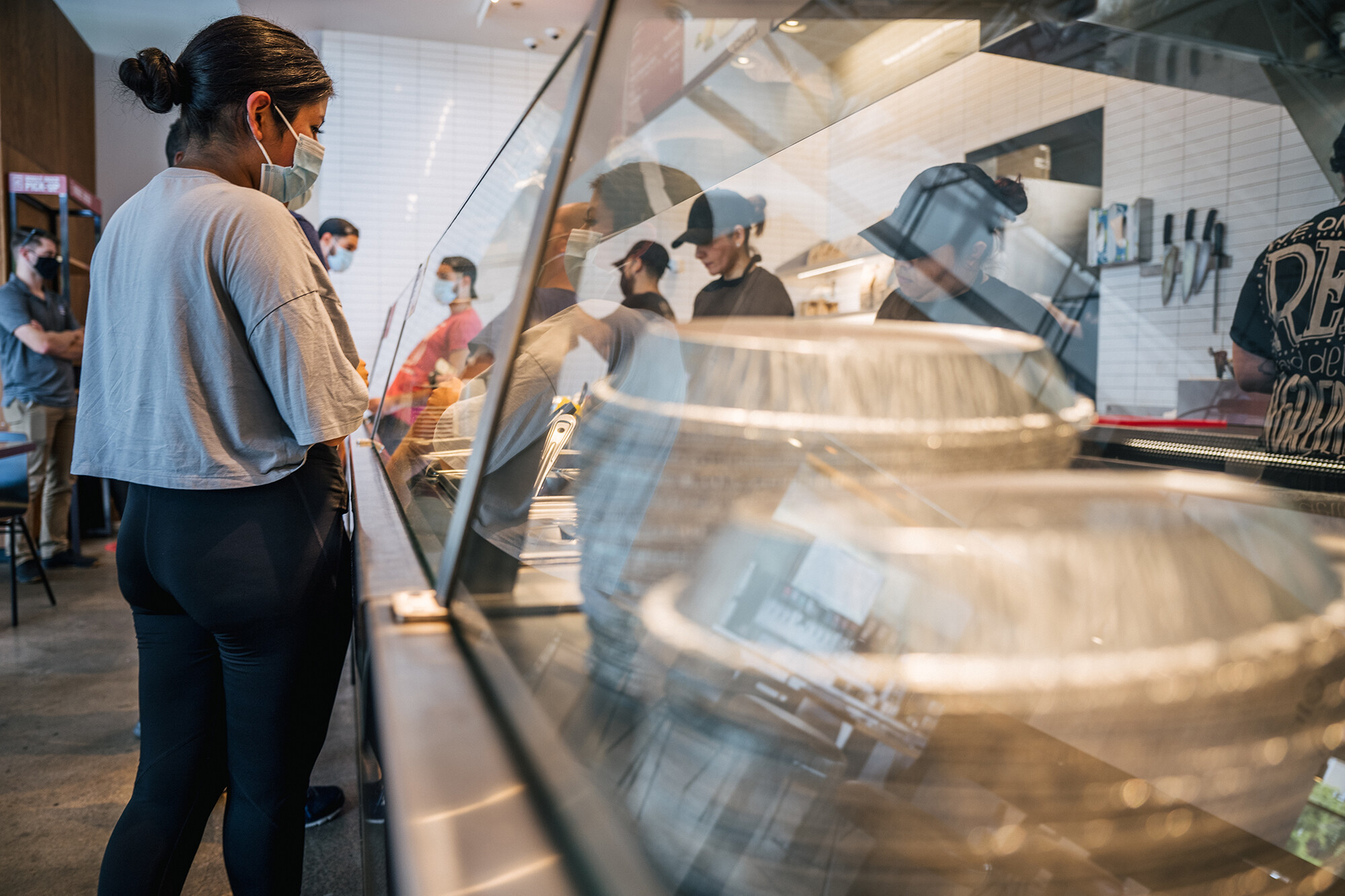 Restaurants are short on staff. Chipotle says raising wages helps
