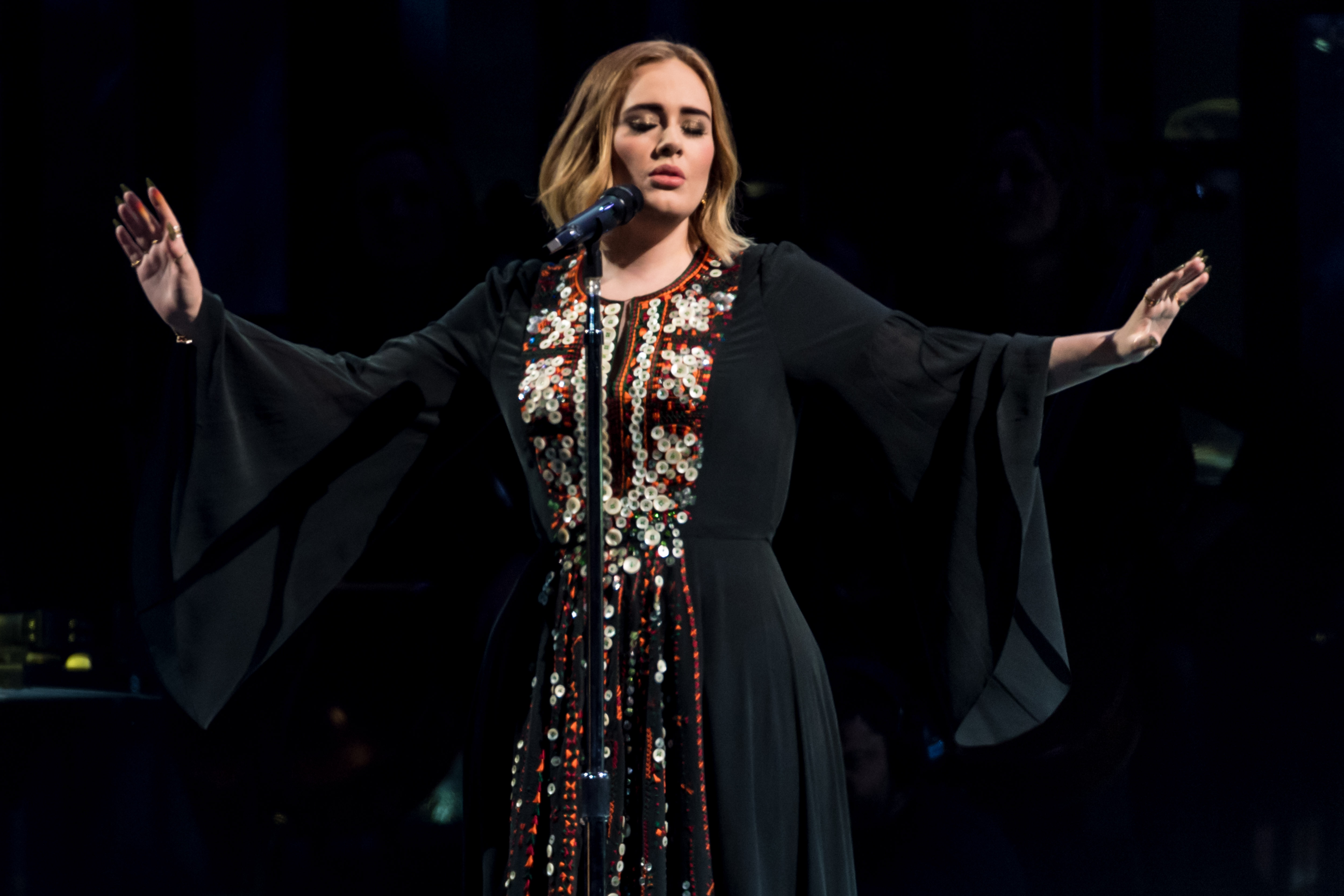 Adele wore her Glastonbury Festival dress to watch it and needs you to calm down about a new album