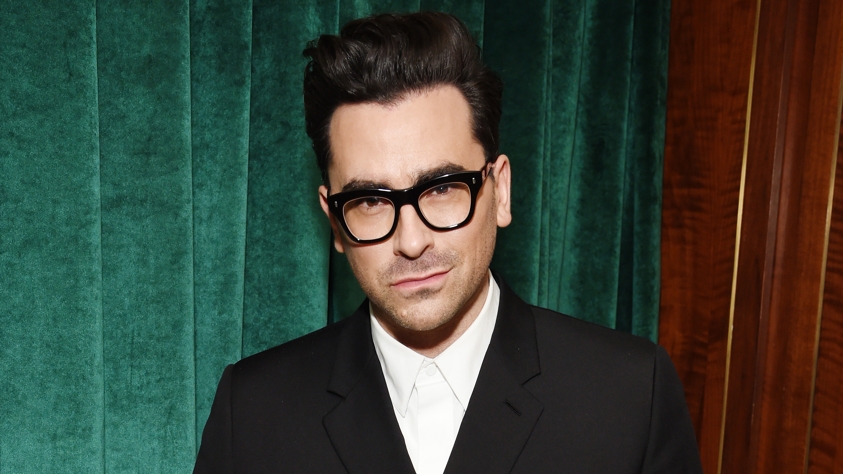 Dan Levy is encouraging face coverings as an act of kindness
