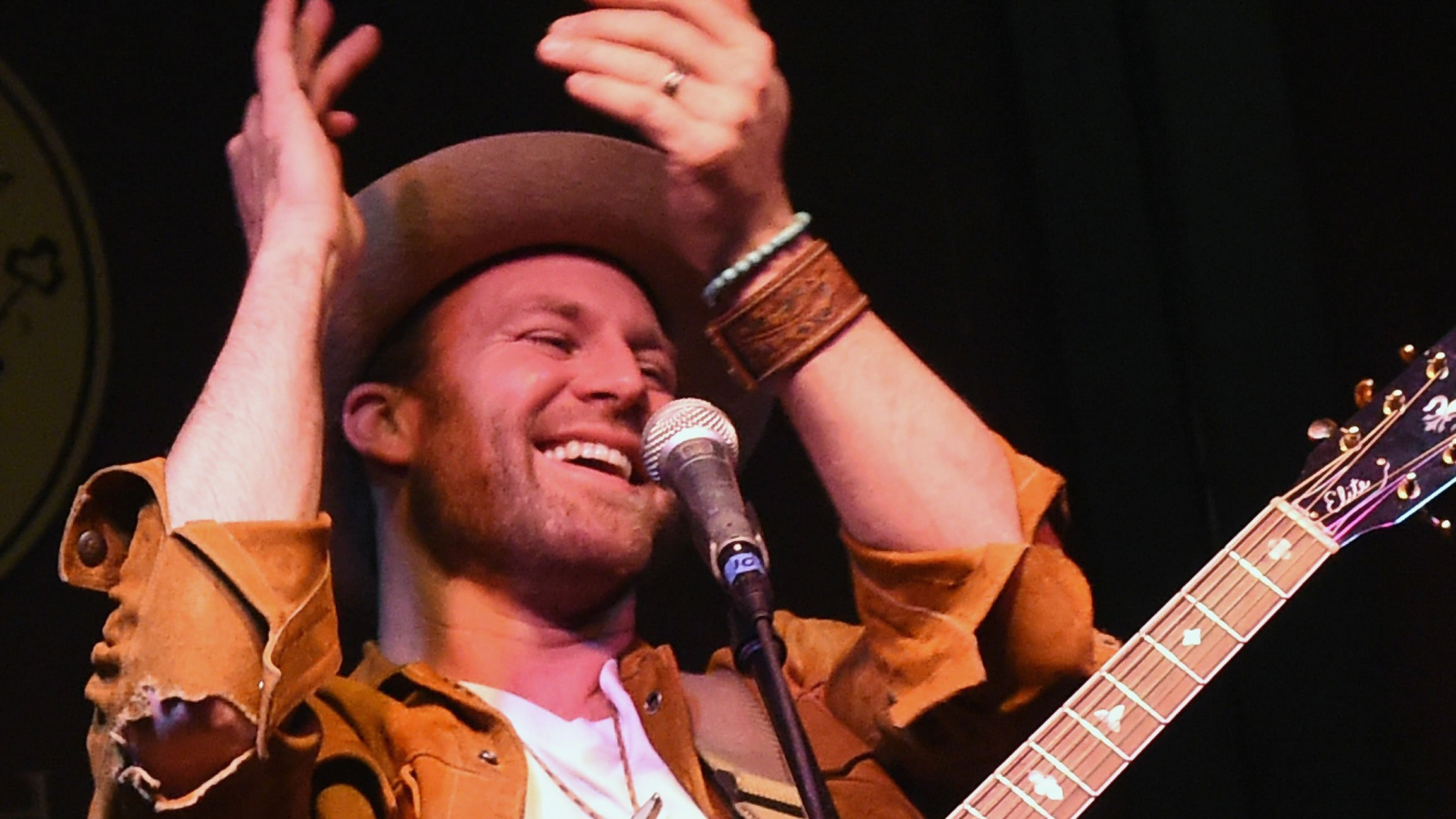 Country singer Drake White rushed to the hospital after almost collapsing onstage