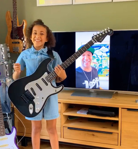 Image for Tom Morello of Rage Against the Machine gifted one of his guitars to a 10-year-old rocker girl