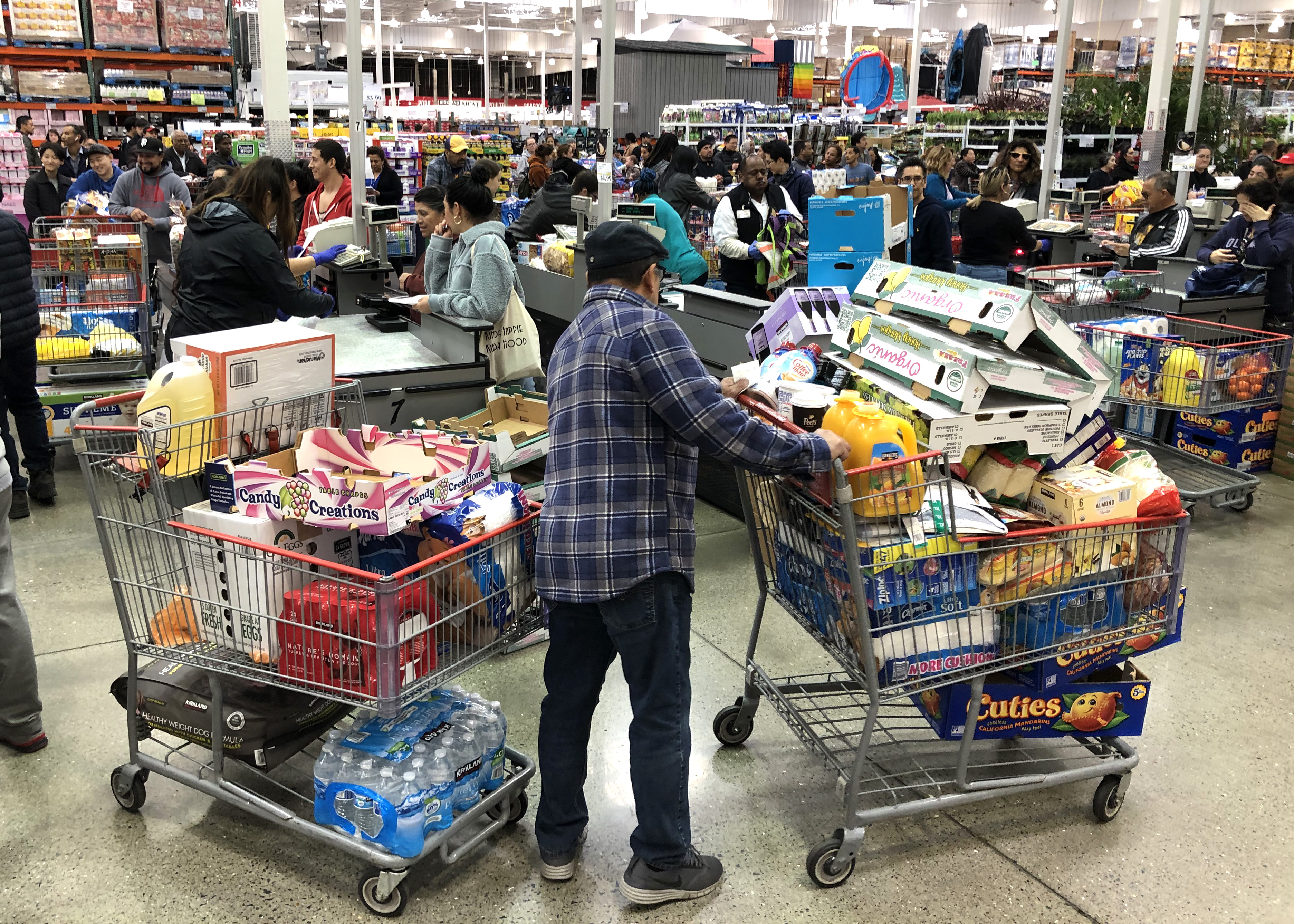 Image result for coronavirus  grocery stores people with full carts