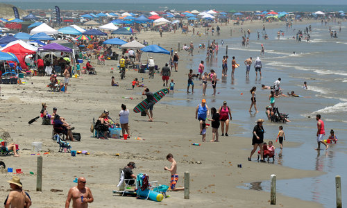 Image for Covid-19 cases surge in some states as Americans celebrate Memorial Day weekend