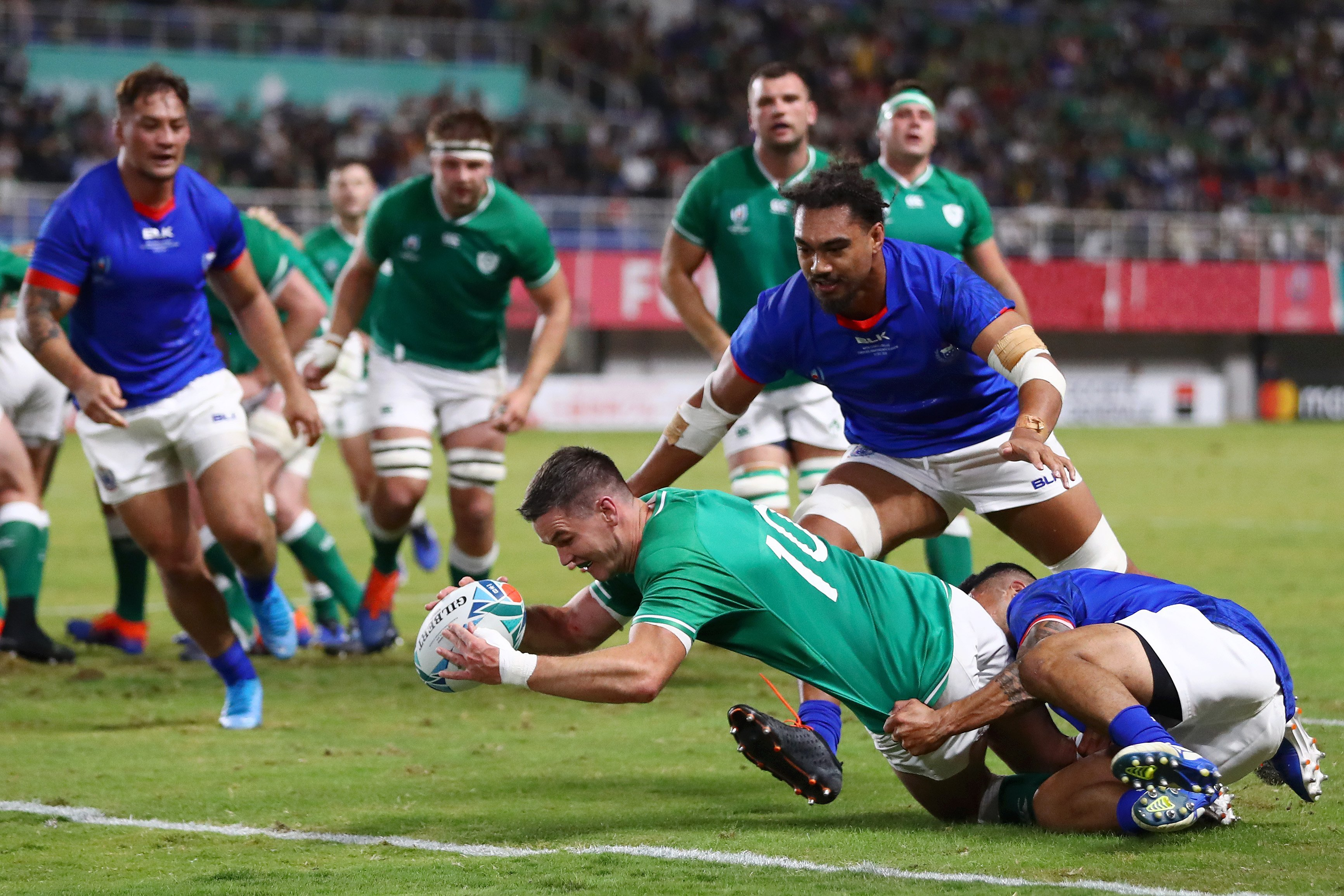 Ireland advances to quarterfinals at rugby's World Cup as Typhoon Hagibis batters host nation