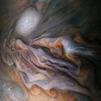 Turbulent storm clouds disrupt Jupiter's colorful appearance