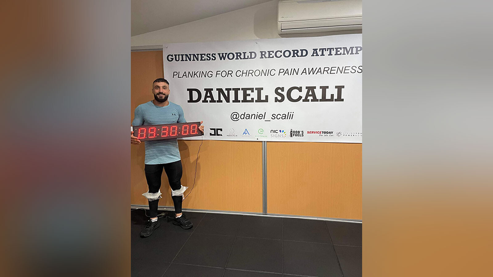 Australian man with chronic pain sets world record by holding plank for over 9 hours