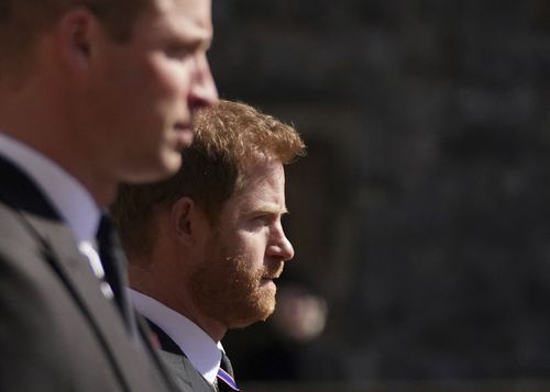 Image for Princes William and Harry walk together after grandfather's funeral
