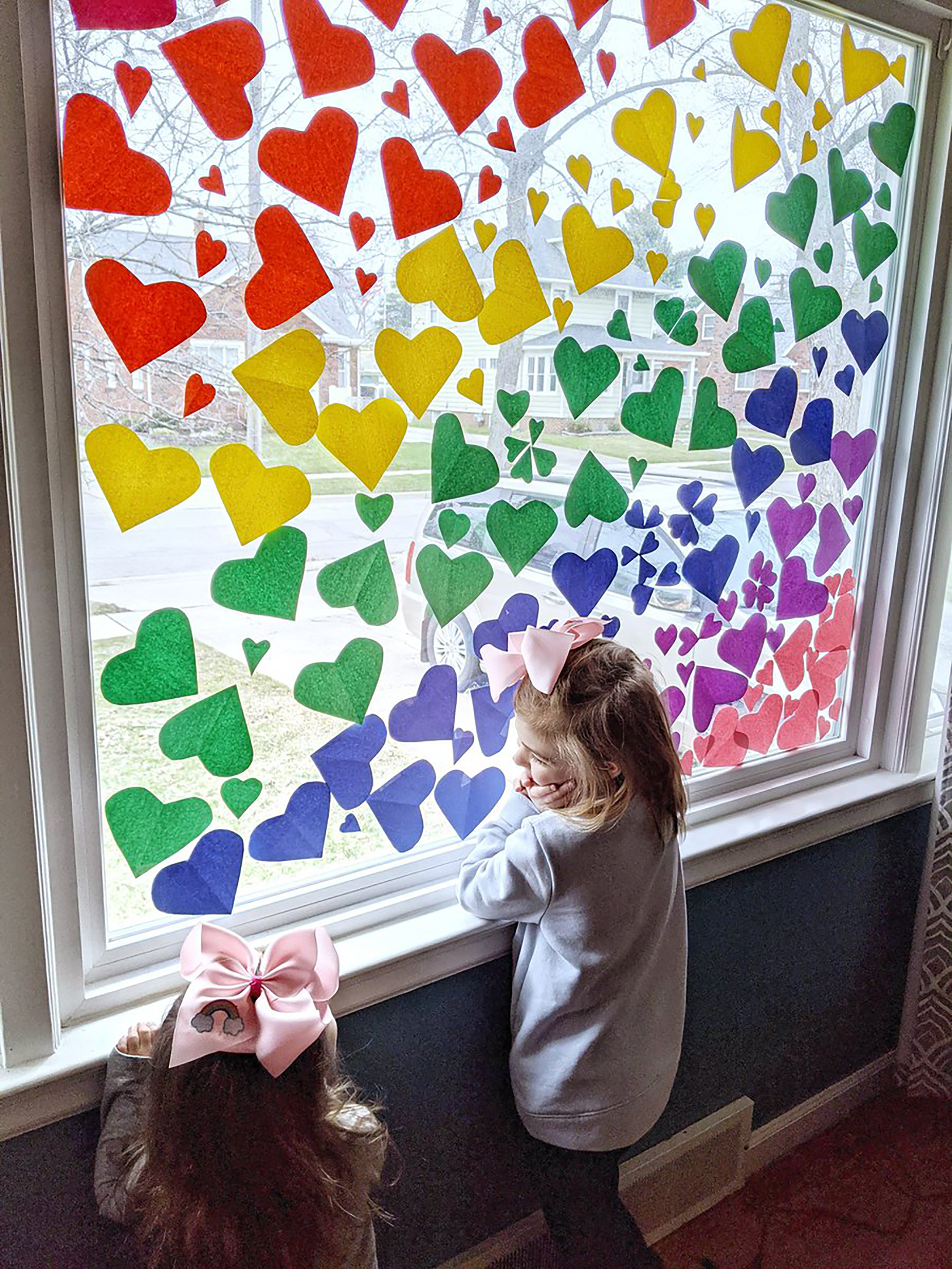 People are decorating their windows with hearts and messages of hope right now