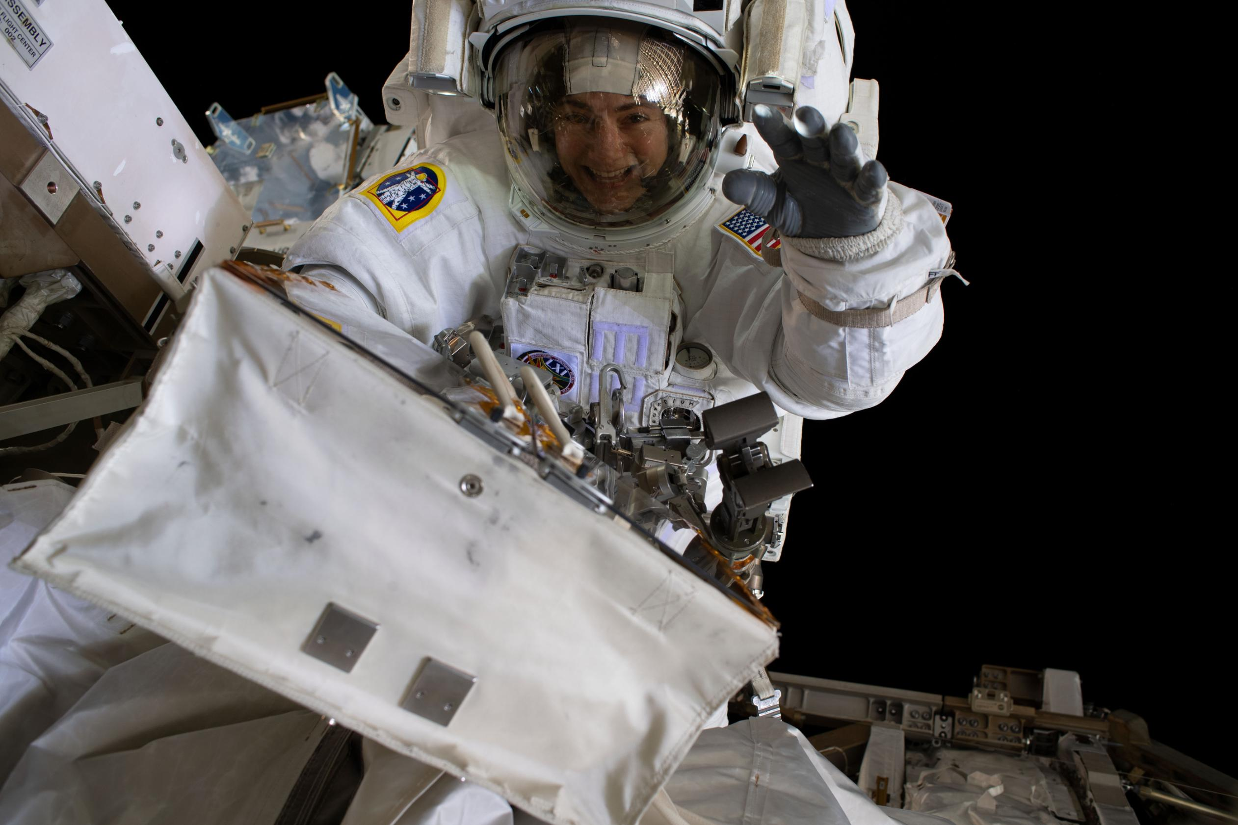 Second all-female spacewalk briefly hampered by helmet issue