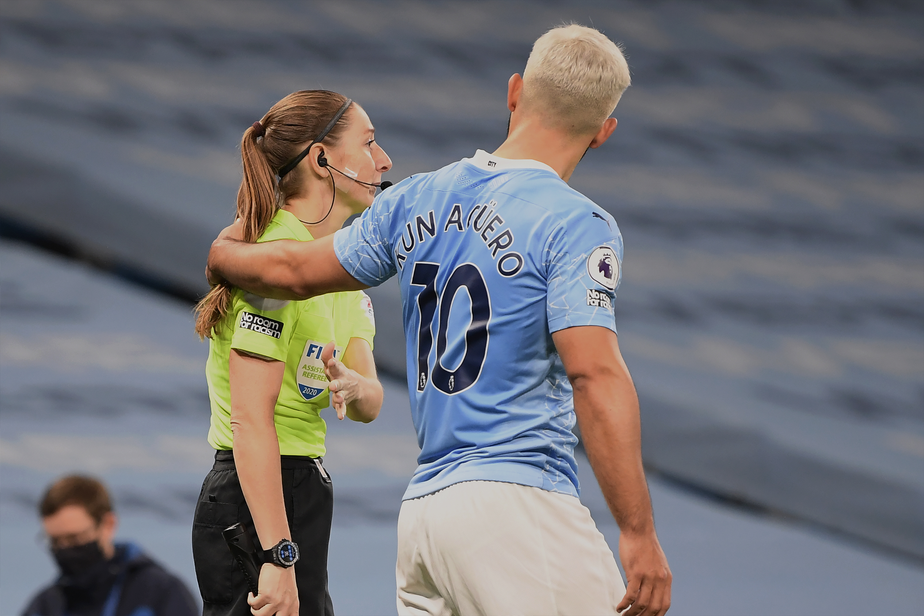 Manchester City star Sergio Aguero widely criticized for putting his hand on the shoulder of a female official