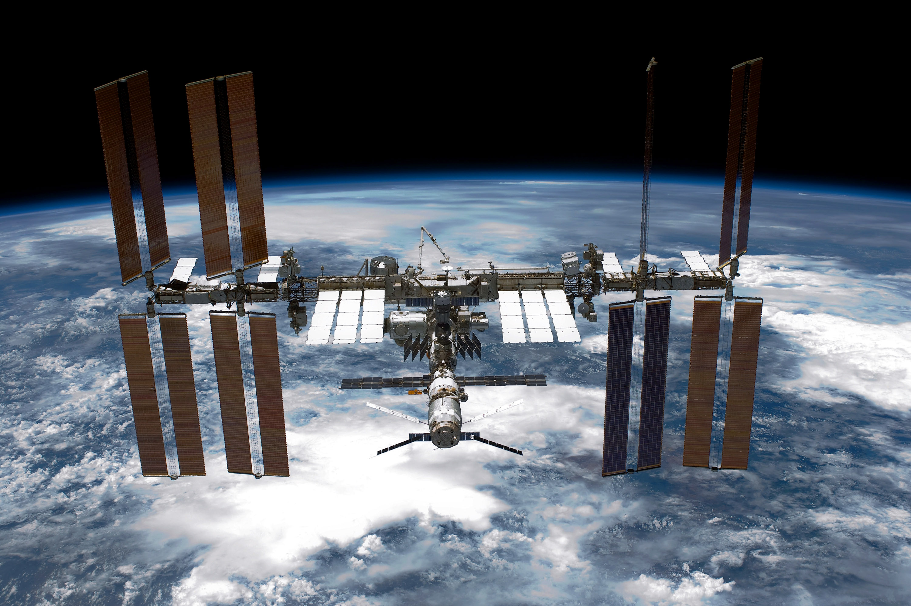 SpaceX Dragon docks with space station, delivering 'mighty mice' and a space robot