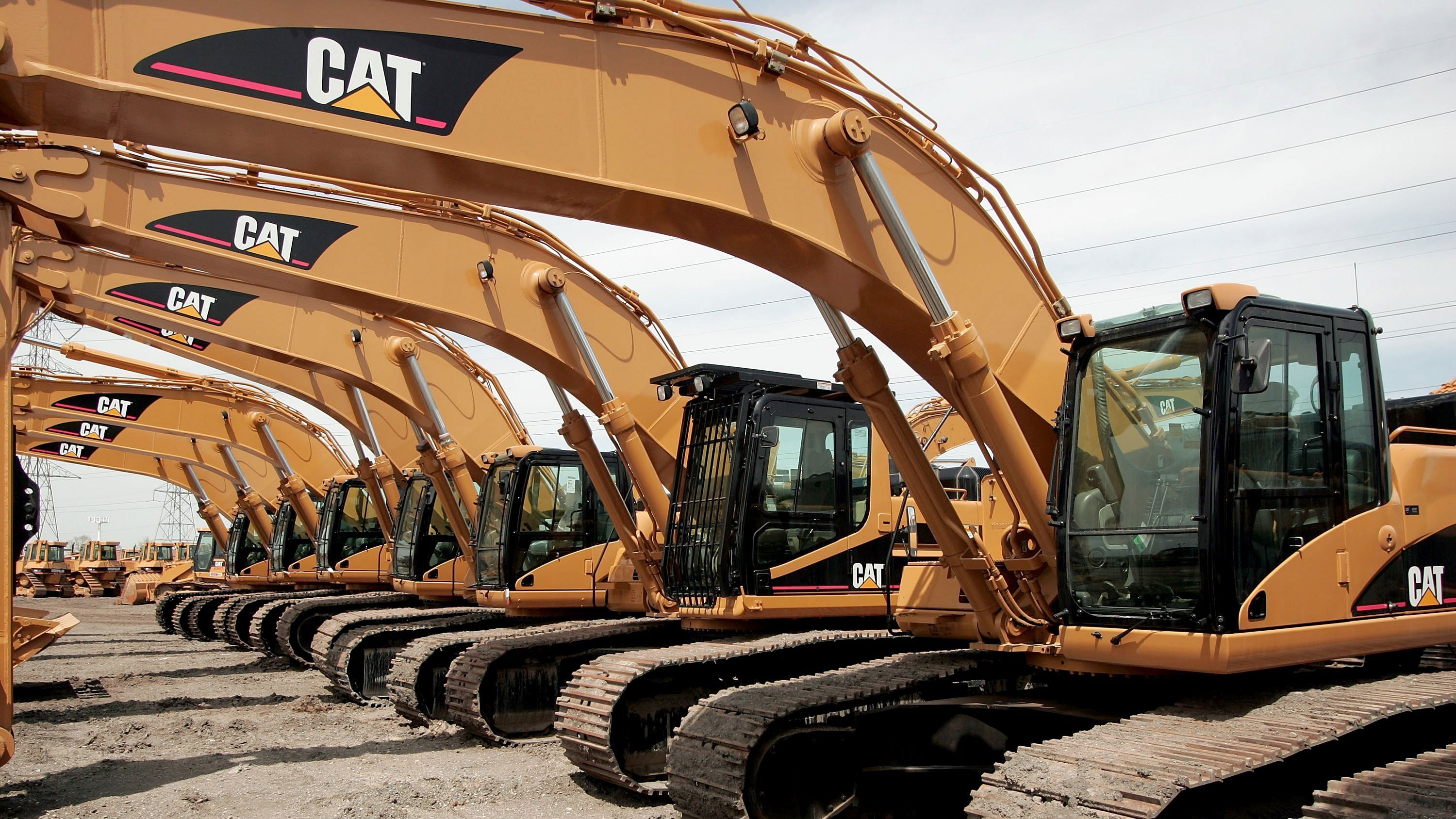 The trade war is stinging Caterpillar, and its outlook is dimming
