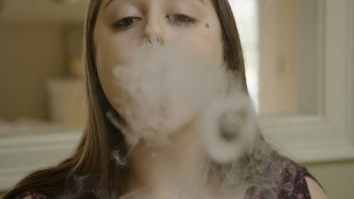 Image for 1 in 3 teens breathe secondhand e-cigarette vapors, new research says