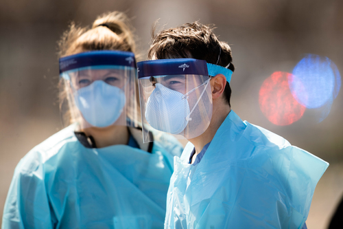 Image for CDC recommends Americans wear face masks voluntarily in public but some officials say they felt 'pressured' to draft new guidelines