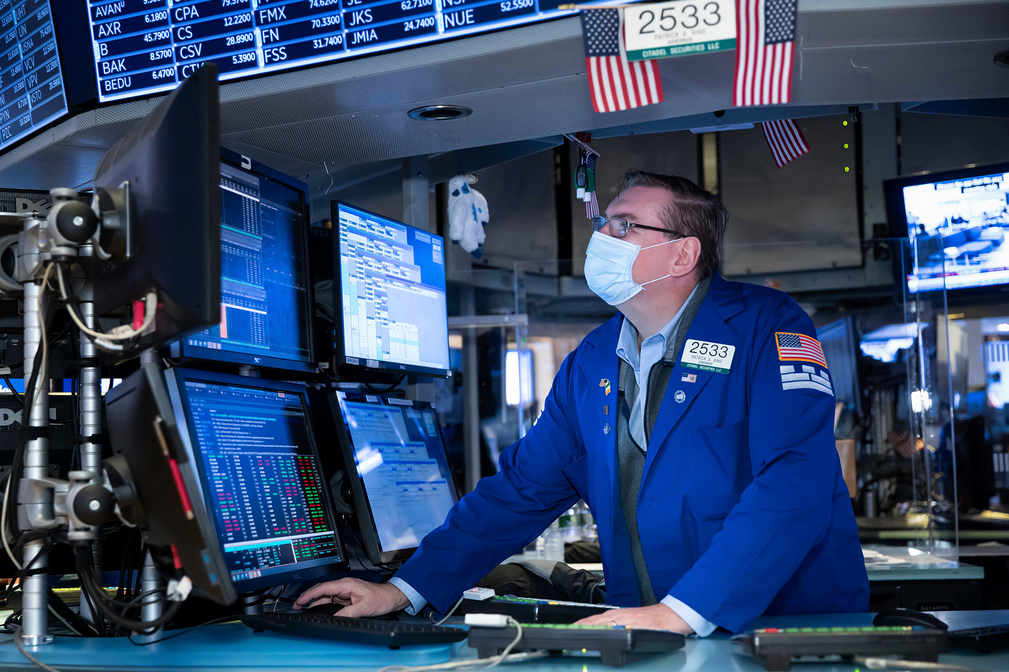 Dow tops 30,000 for the first time ever as Biden transition begins