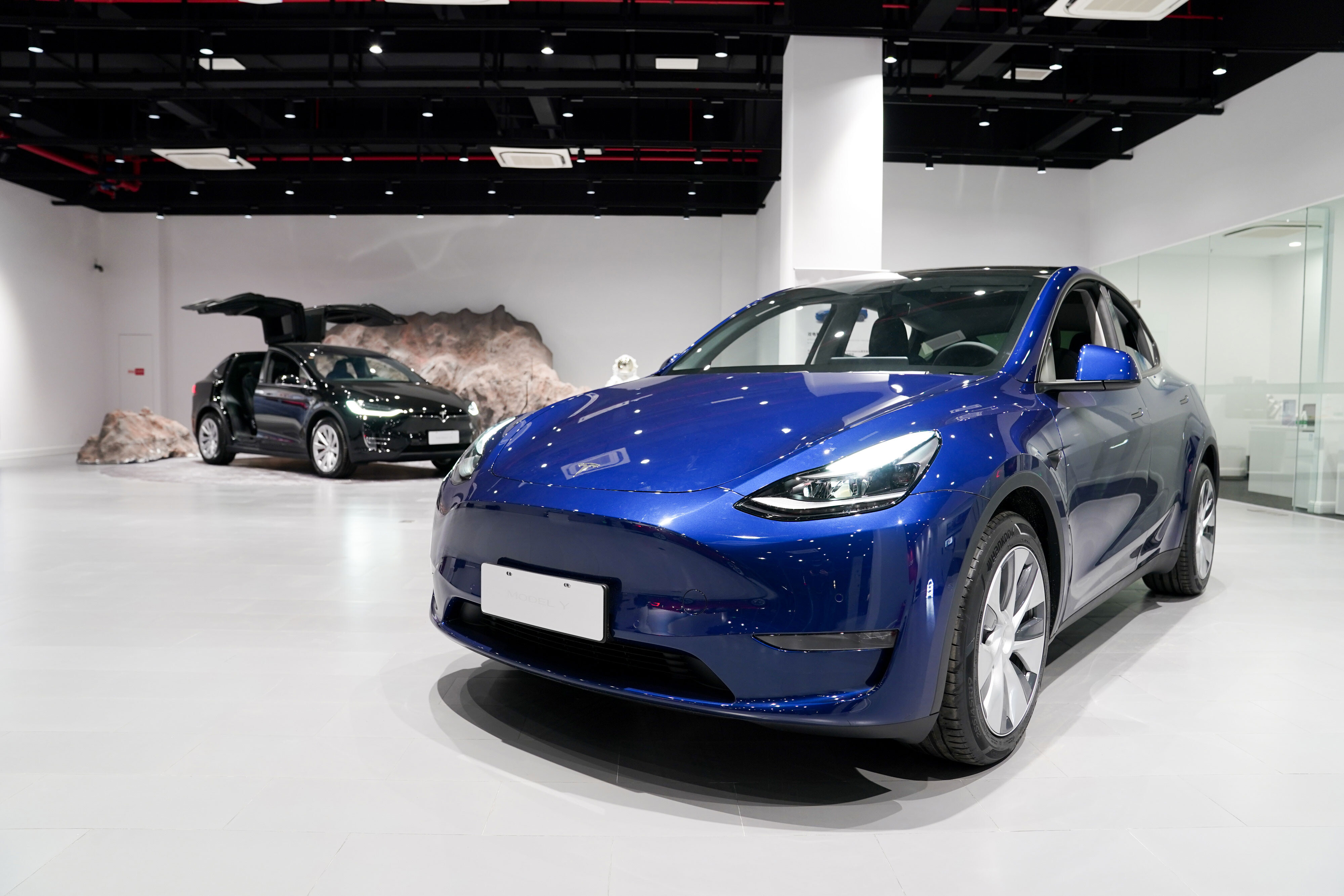 Here are 8 things investors will be looking for in Tesla's earnings report