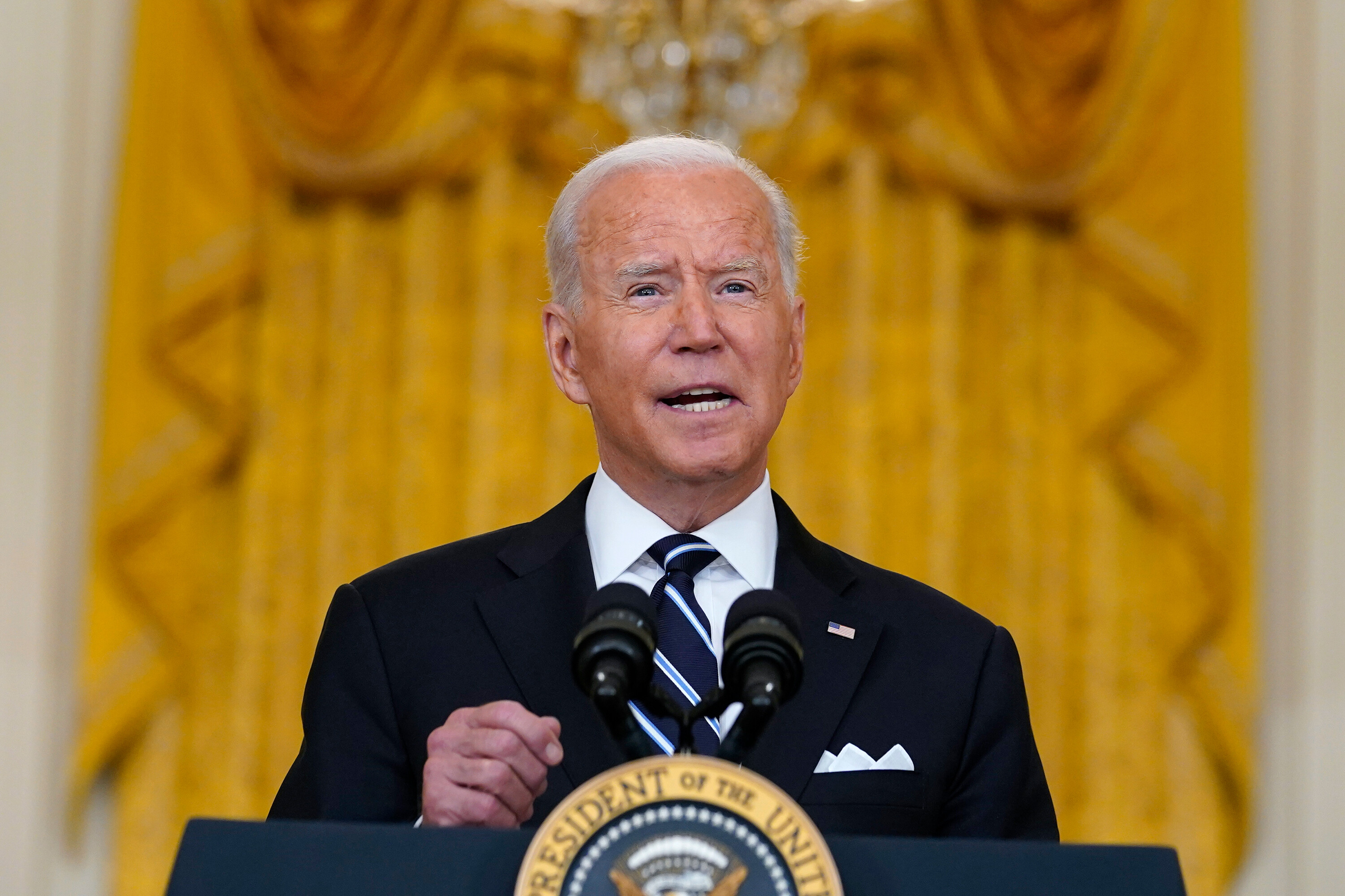 President and first lady plan to get their Covid-19 vaccine booster shots once they're eligible, Biden says