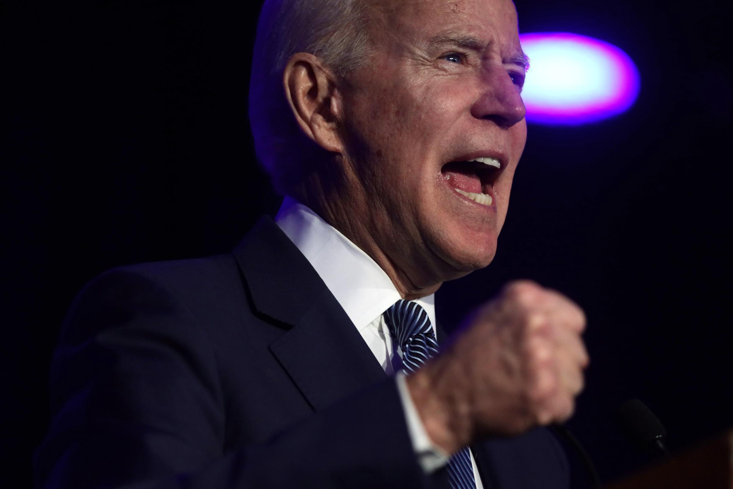 Biden slams Sanders and 'cowards' in Congress over gun violence
