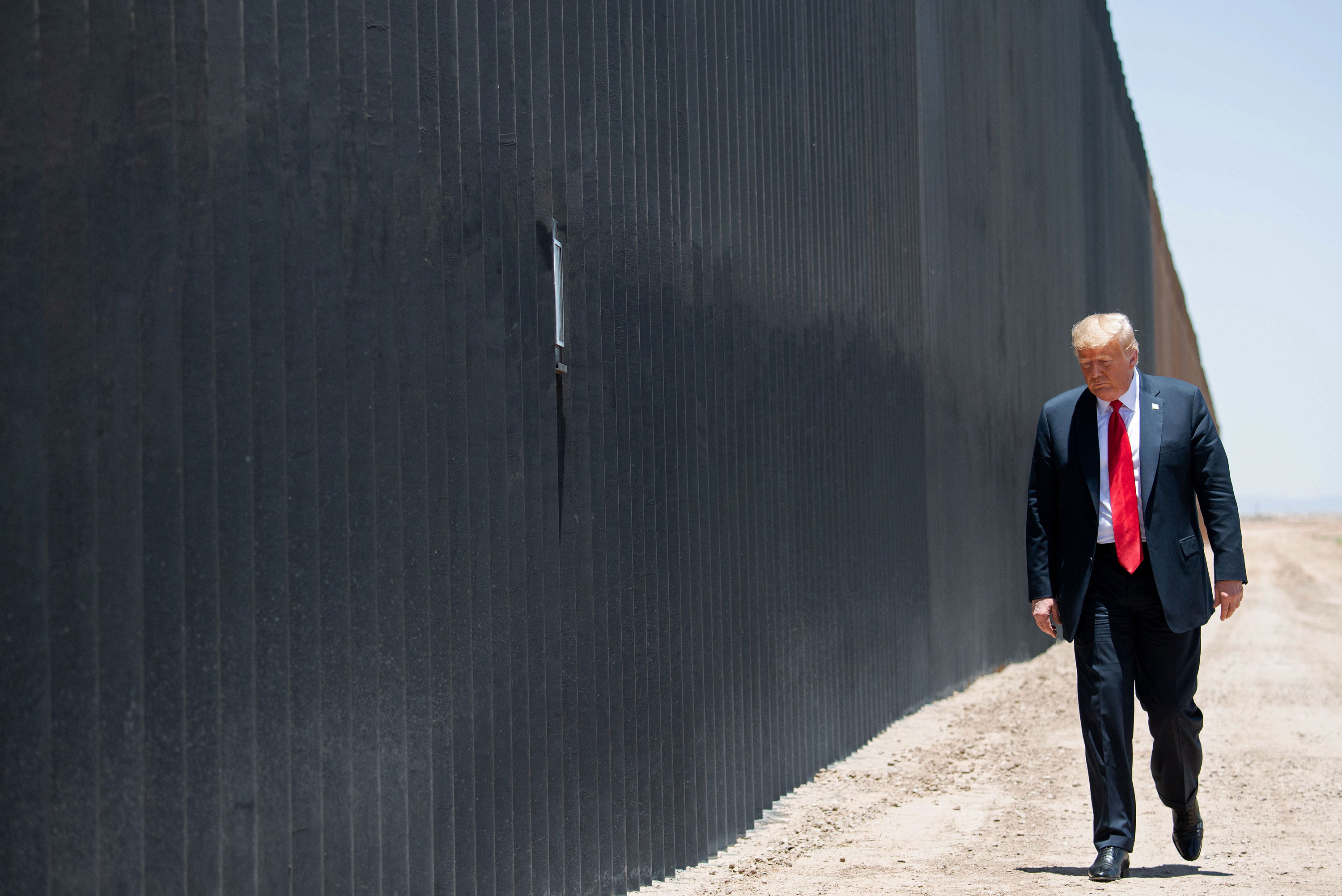 Biden's desire to stop the border wall could be costly and arduous
