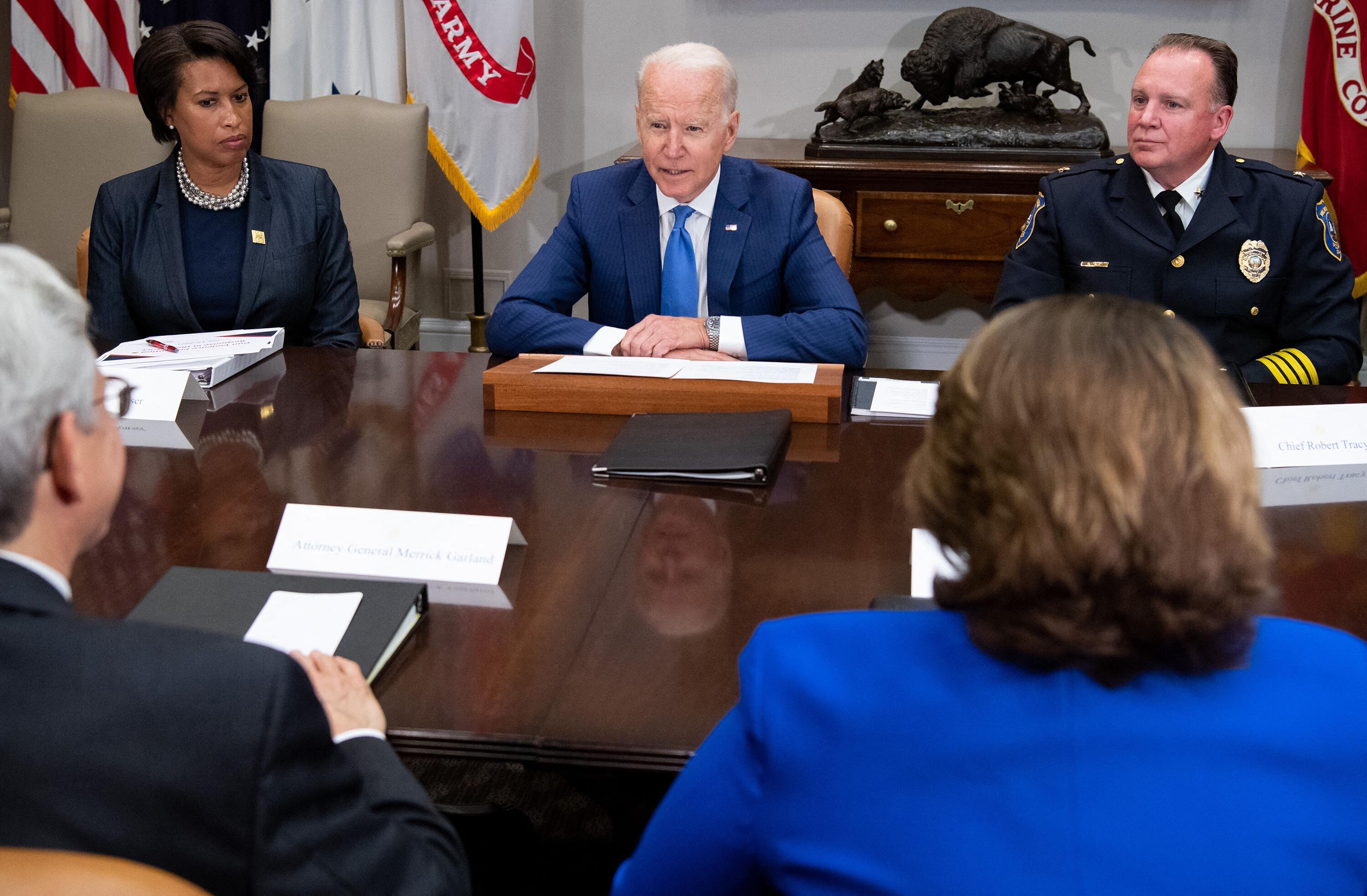 Biden tries to hold the center as Democrats clash over police and public safety