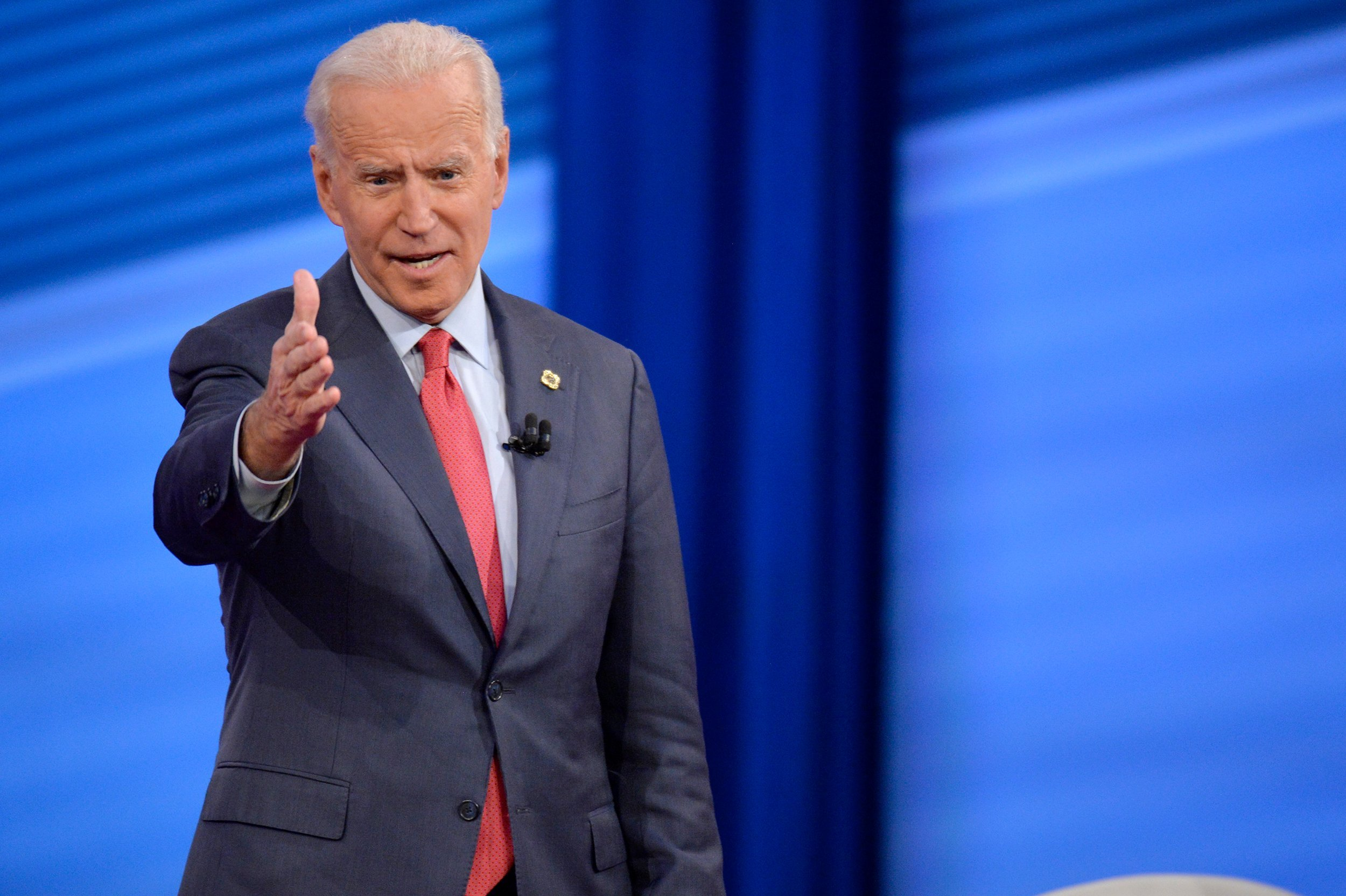 Biden hits Warren's 'you do it my way' attitude and 3 other CNN town hall takeaways