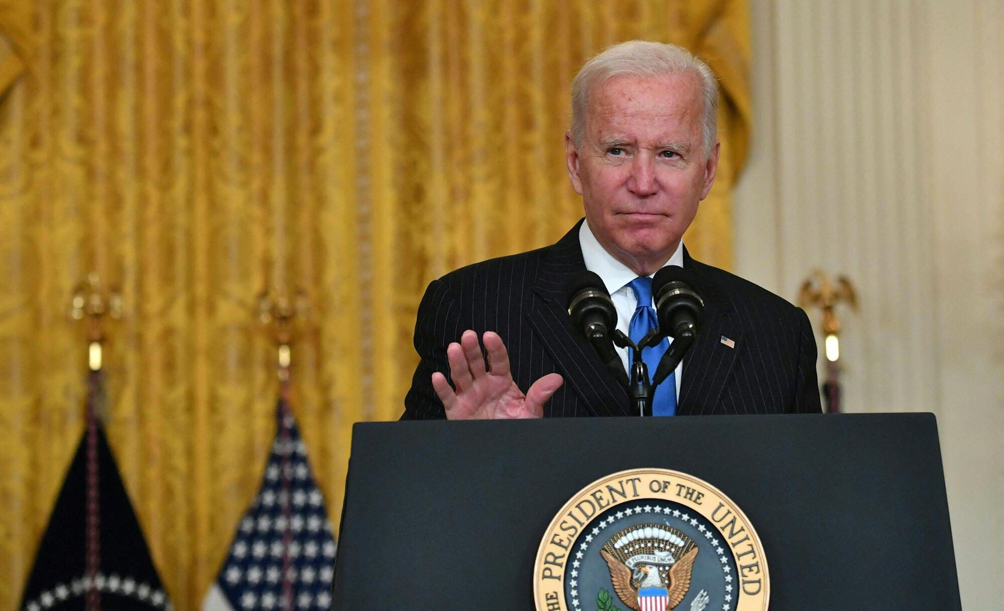 Biden says nation is 'headed in the right direction' on Covid but now is a 'very critical period'
