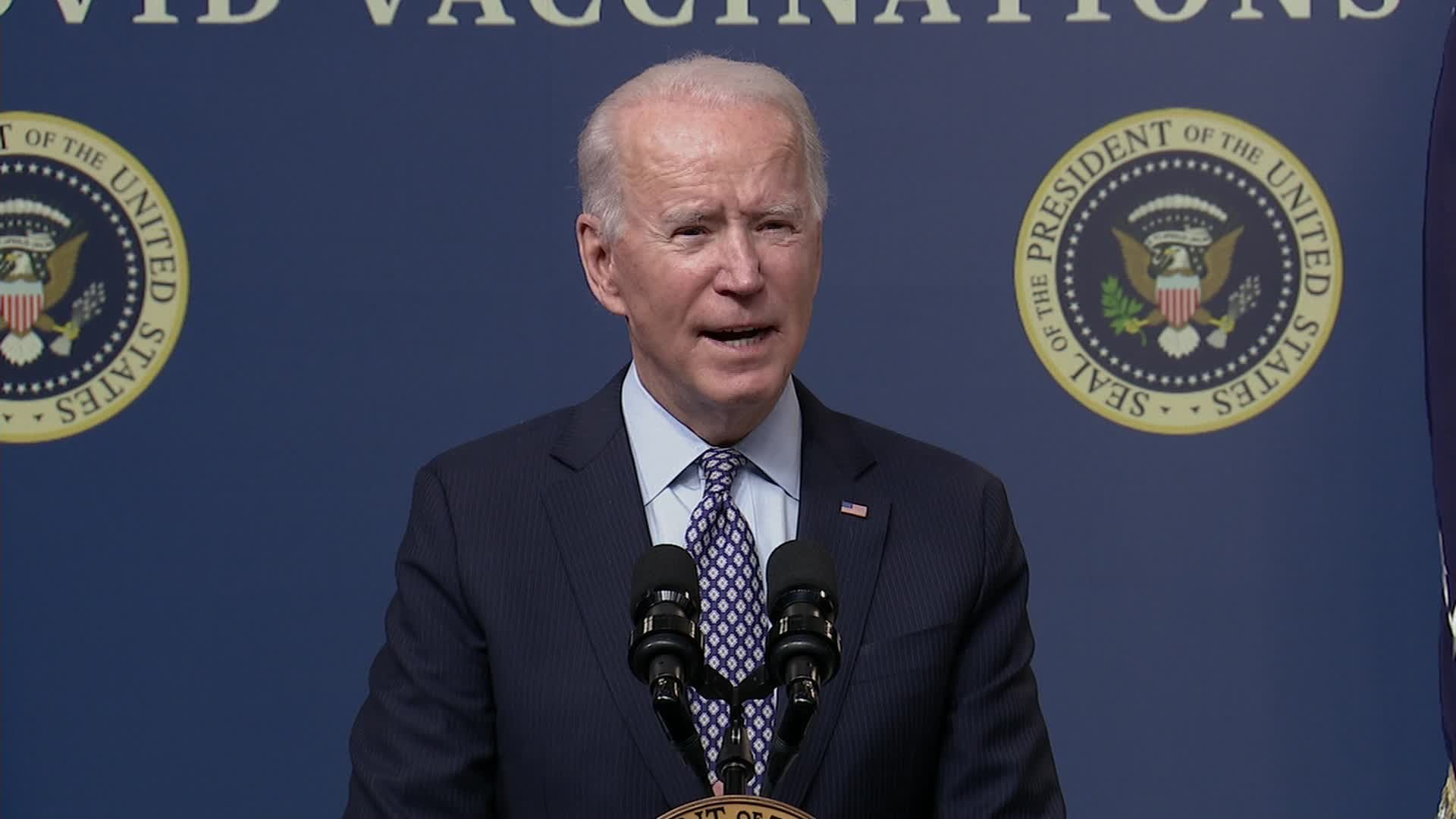 Biden marks 50 million vaccine doses but cautions there's a 'long way to go'