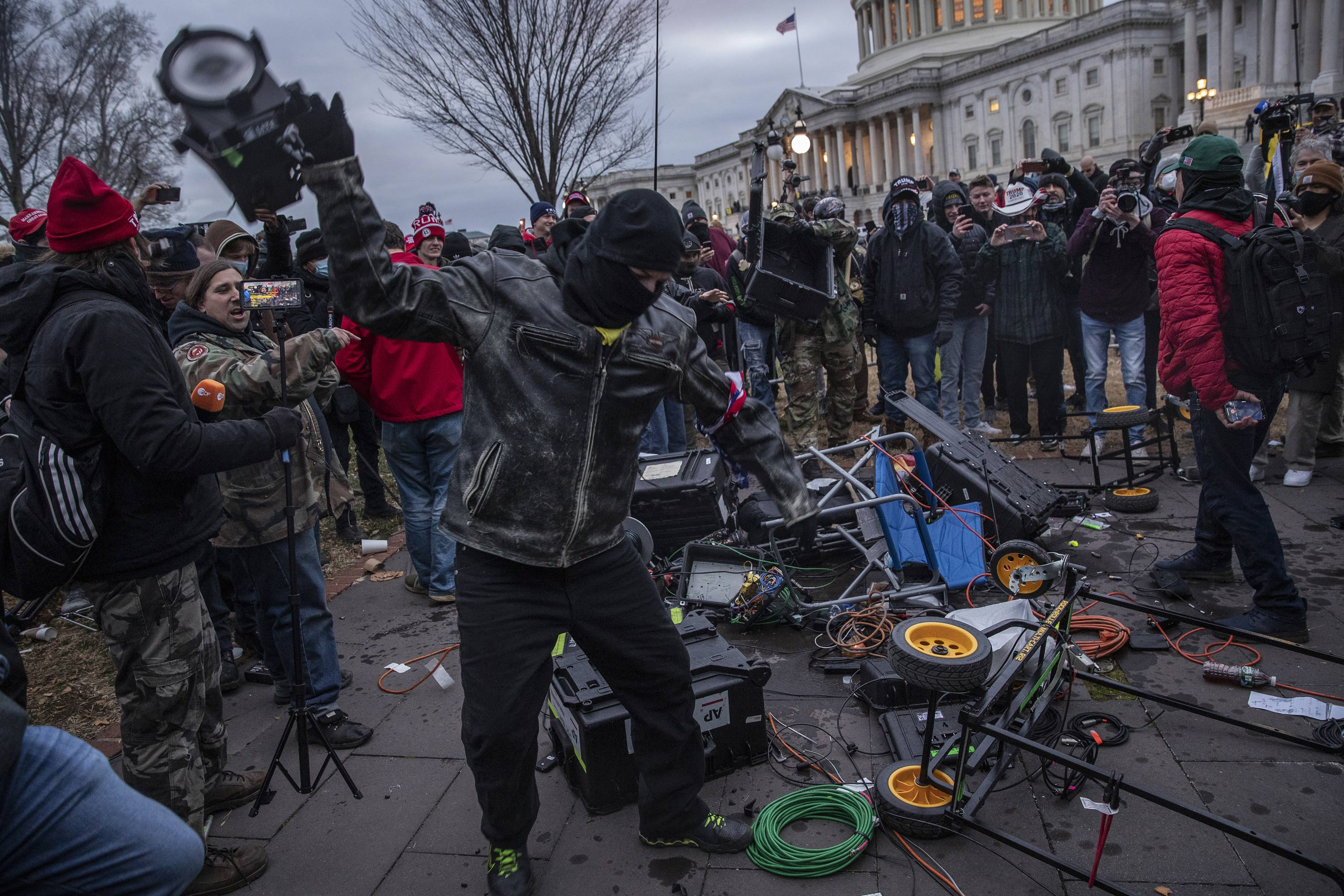 Capitol rioters smashing media equipment prompt several new criminal cases
