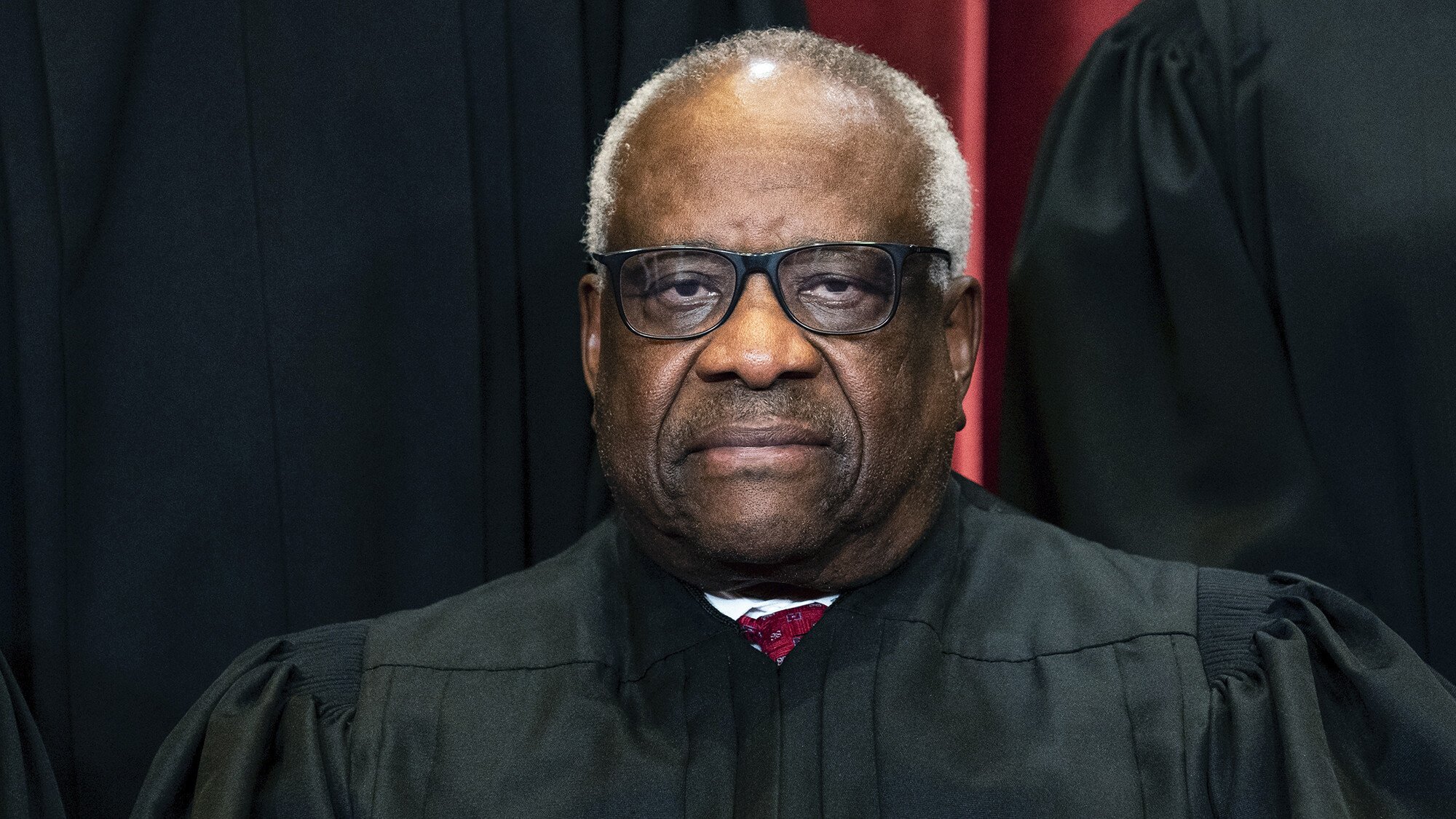 Justice Clarence Thomas asks the first question and other highlights from opening day at the Supreme Court