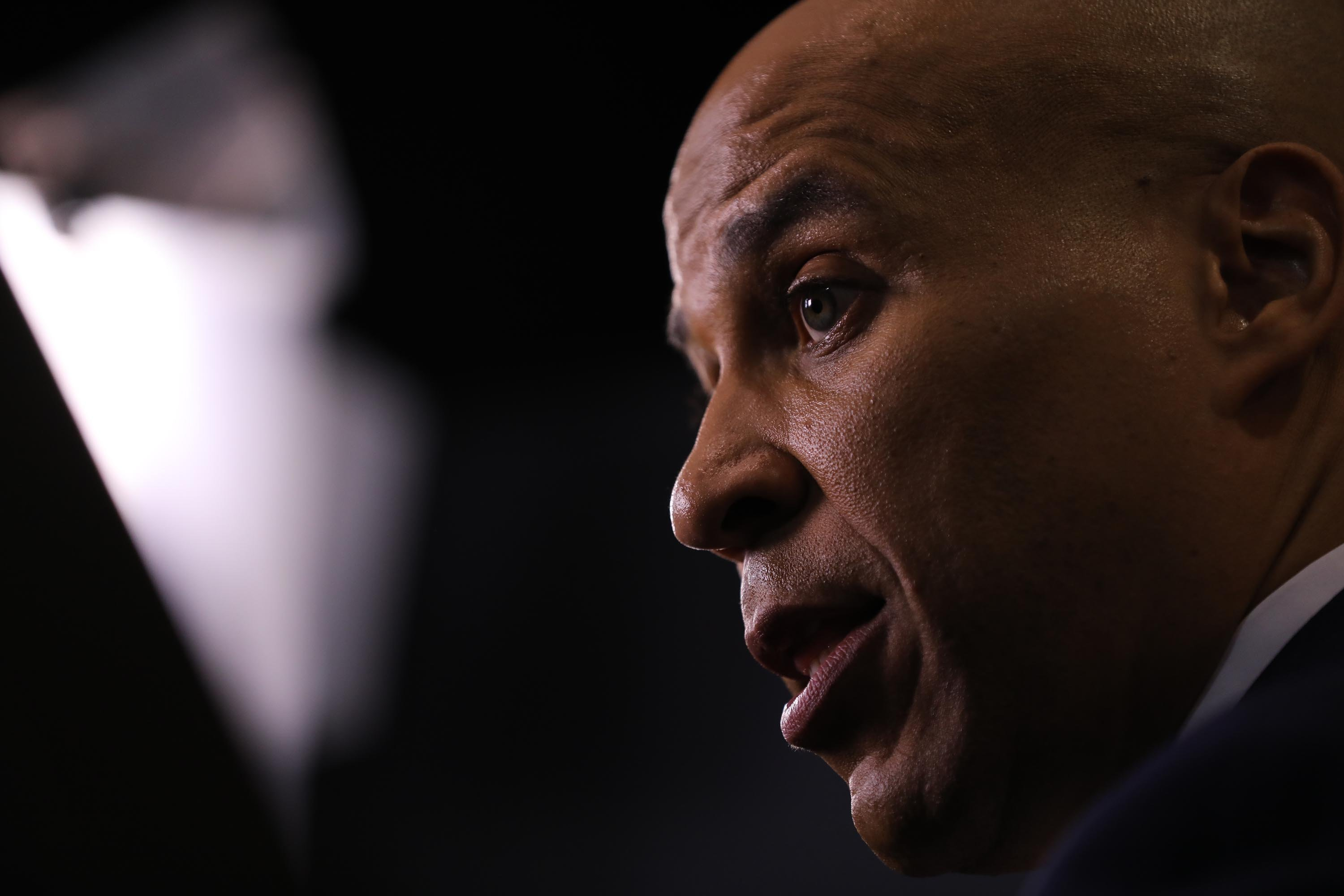 Cory Booker is poised to miss the next debate. He's vowing to fight on anyway.