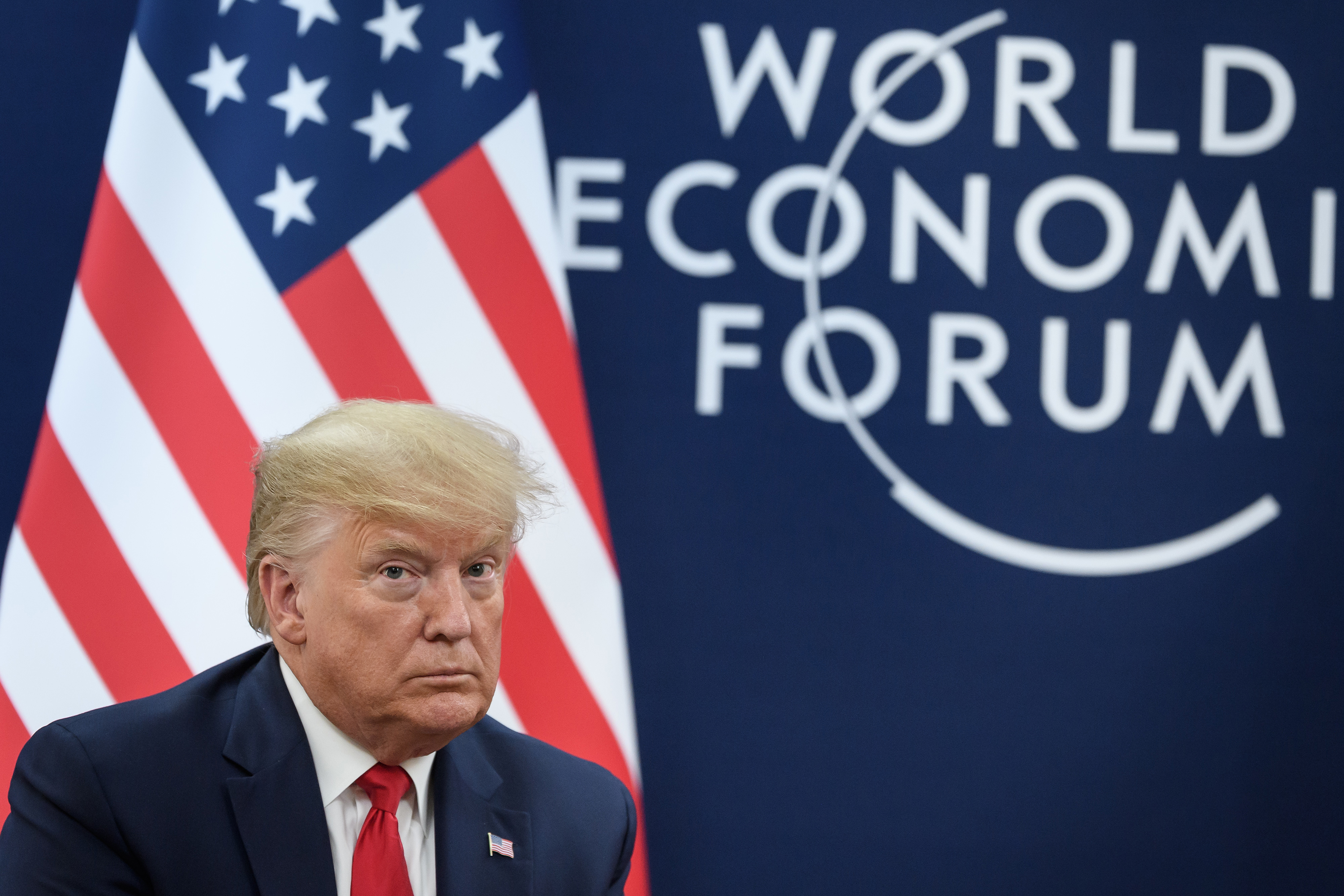 Trump and top administration officials run for impeachment cover in Davos