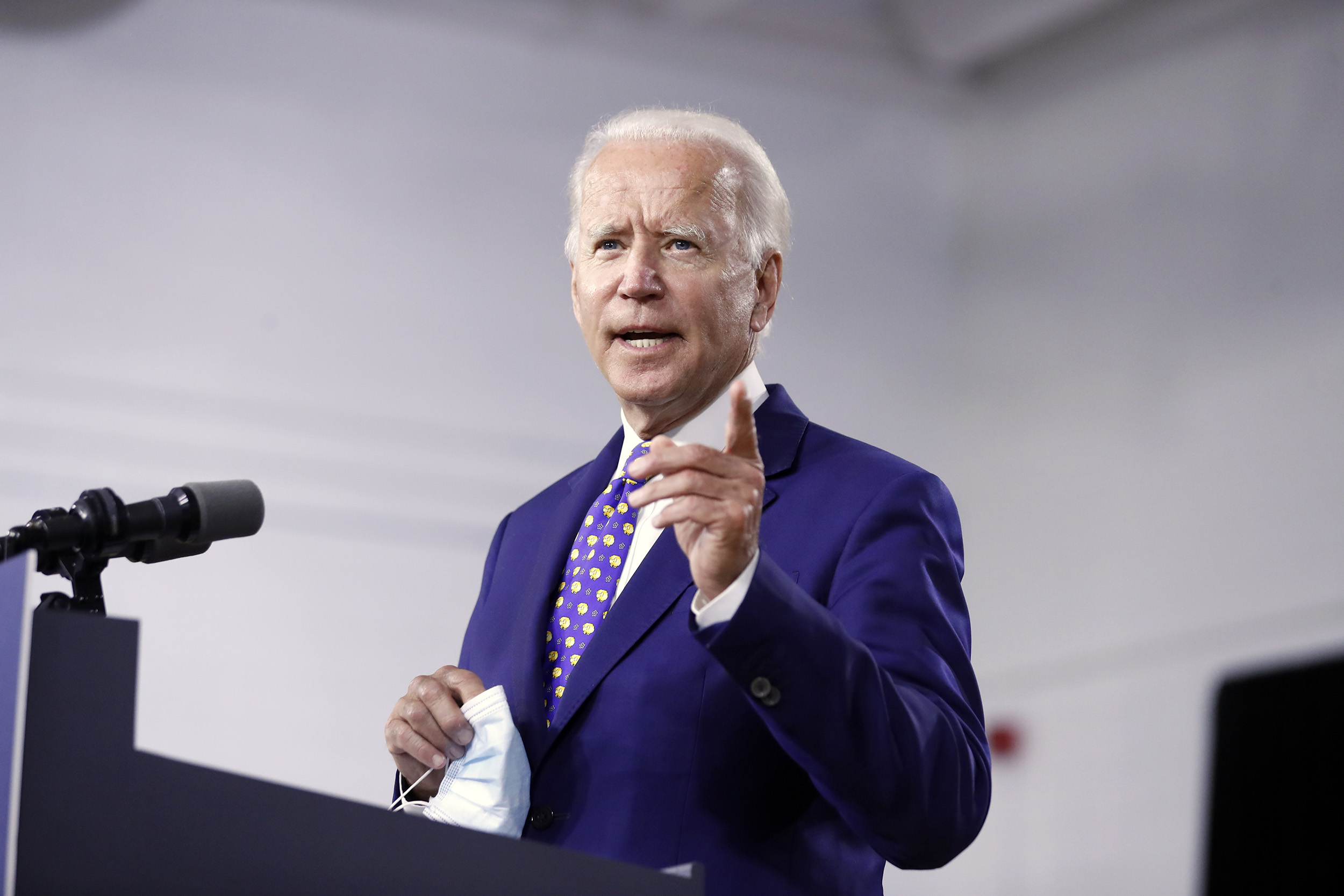 Fact check: Trump ad edits out microphone and trees from Biden photo to make him seem alone in basement