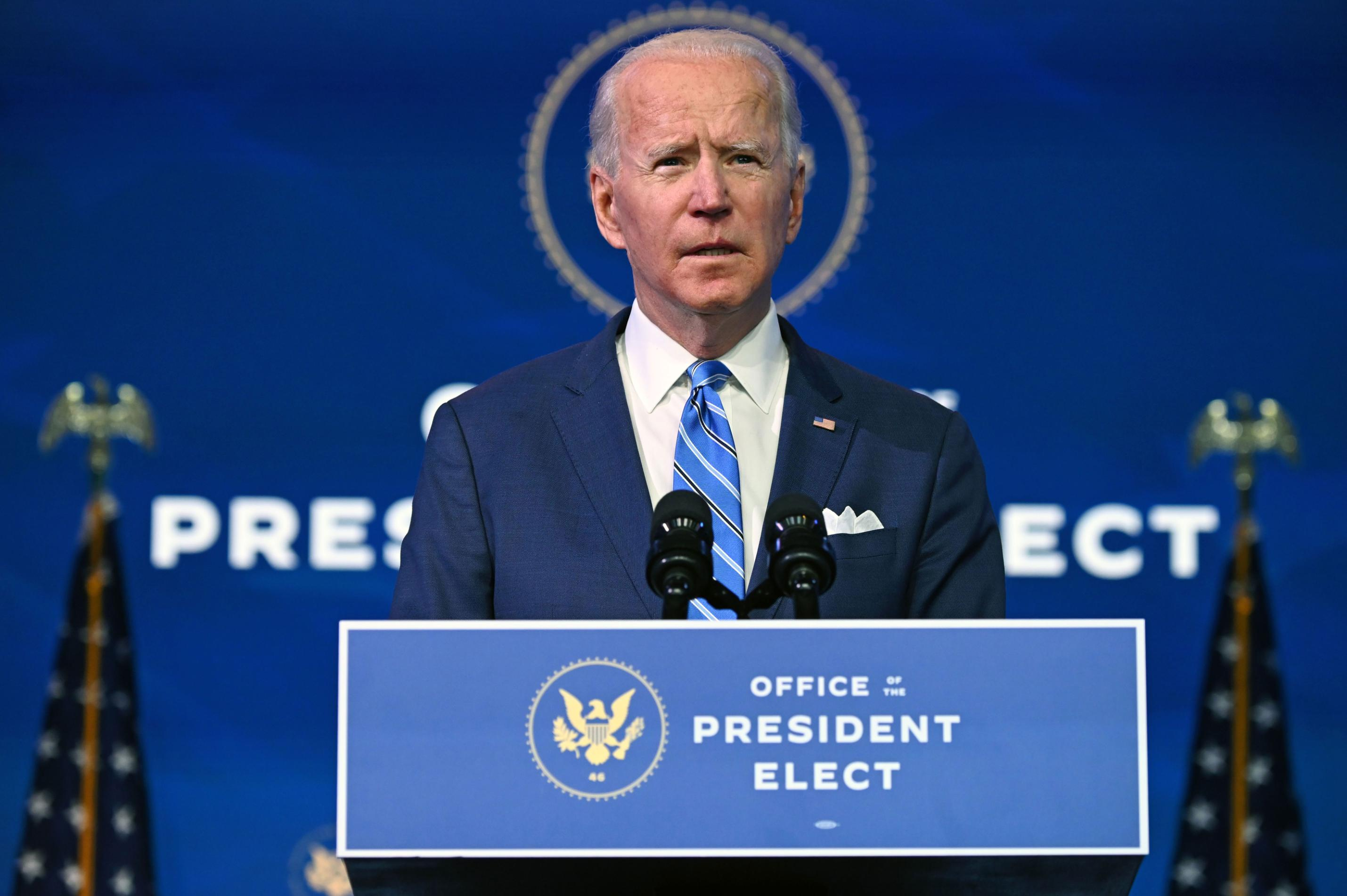 Biden to sign executive orders rejoining Paris climate accord and rescinding travel ban on first day
