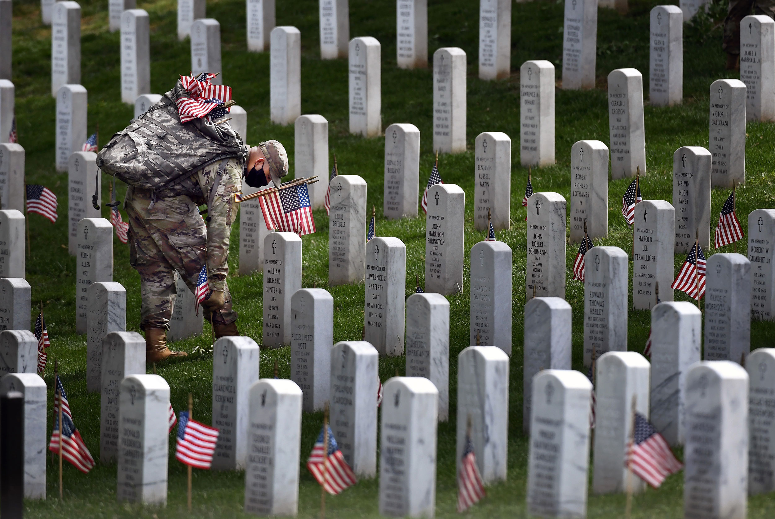 Solemn rituals remain but with new precautions at Arlington National Cemetery this Memorial Day