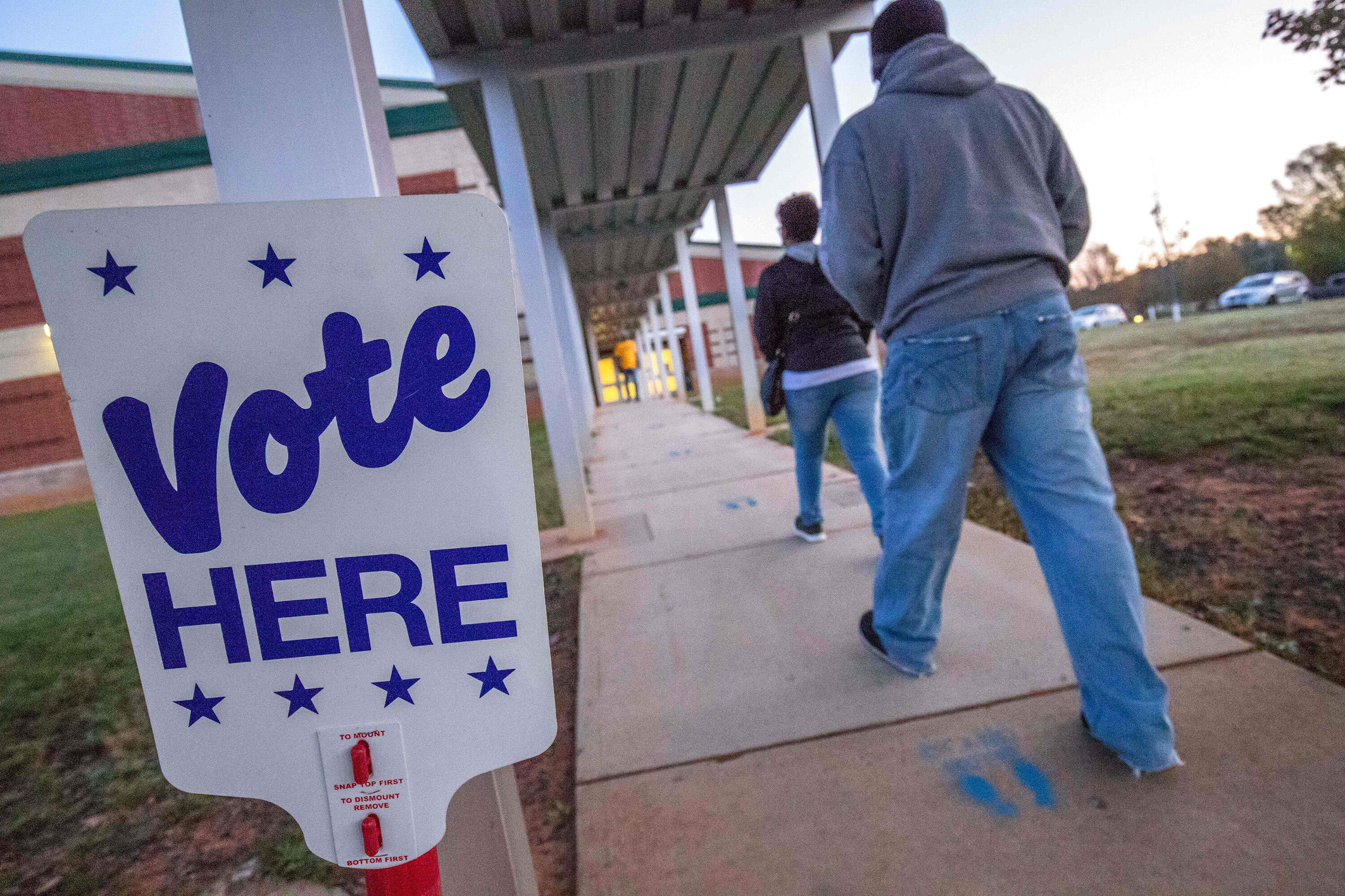 Civil rights groups hail court ruling they say will allow tens of thousands of ex-felons to cast ballots in North Carolina