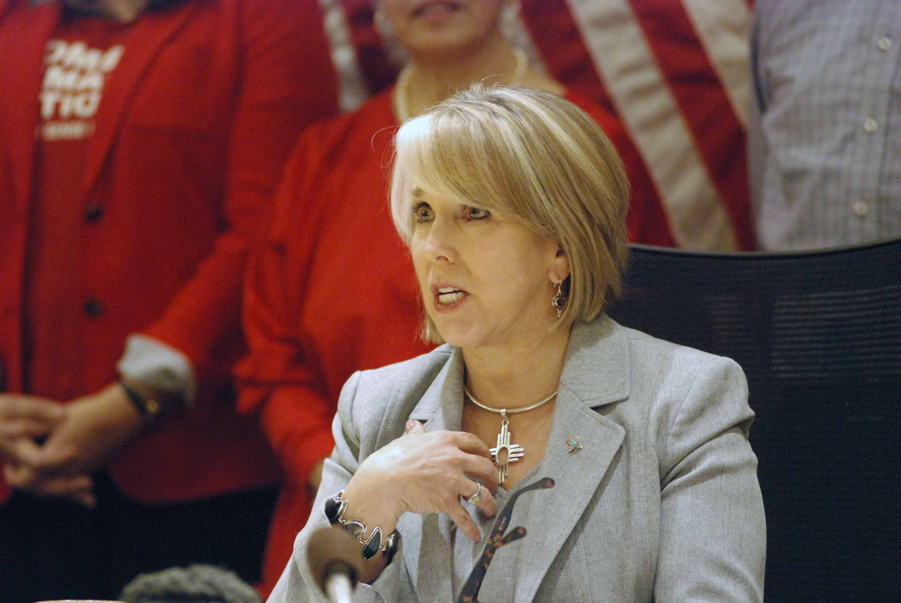 New Mexico's governor signed a red flag gun measure into law and urged sheriffs to enforce it or resign