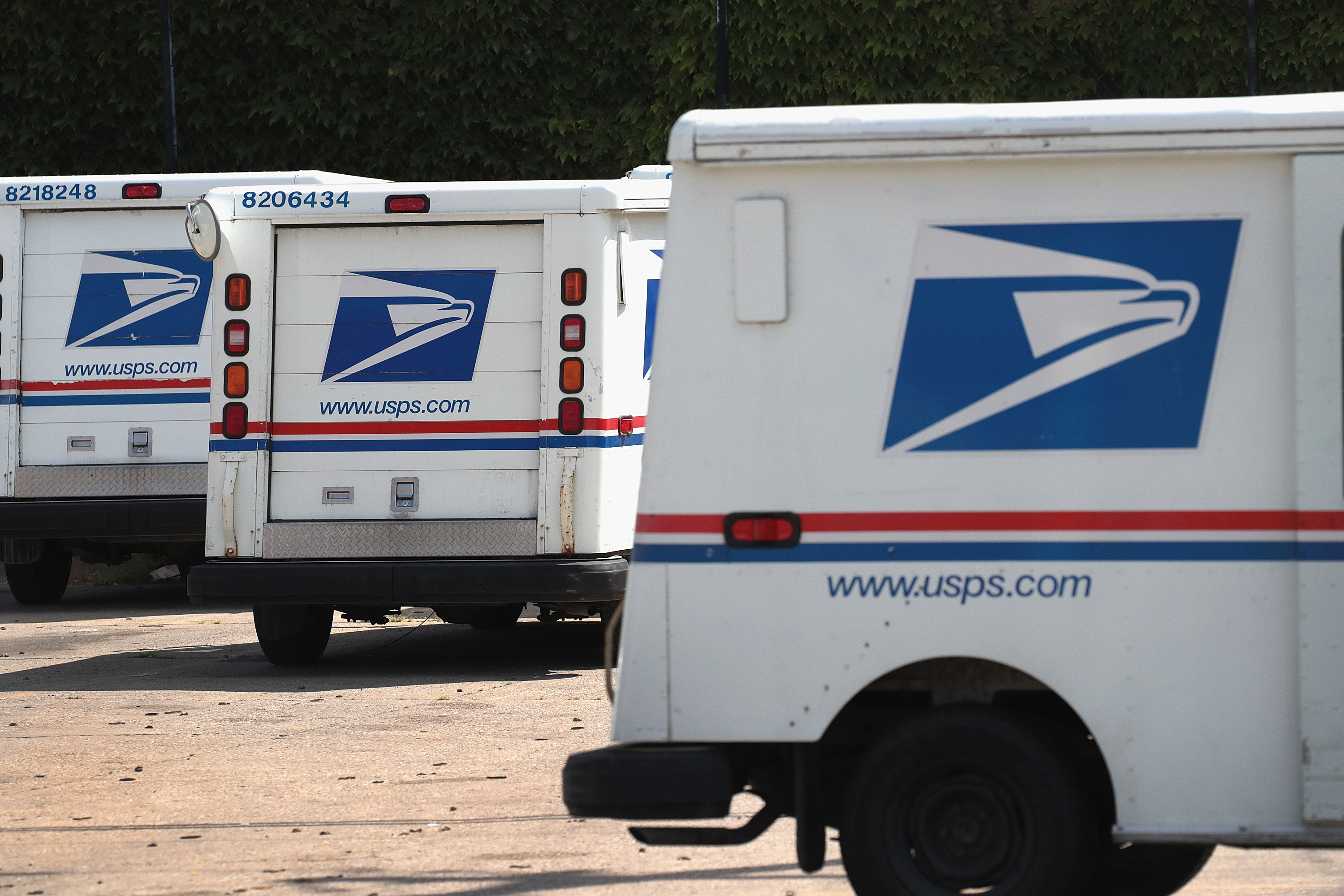 Postal Service says it has 'ample capacity' to handle election after Trump casts doubt