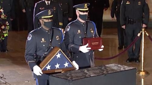 Image for Bidens pay their respects to Capitol Police Officer Brian Sicknick as officer lies in honor at Capitol