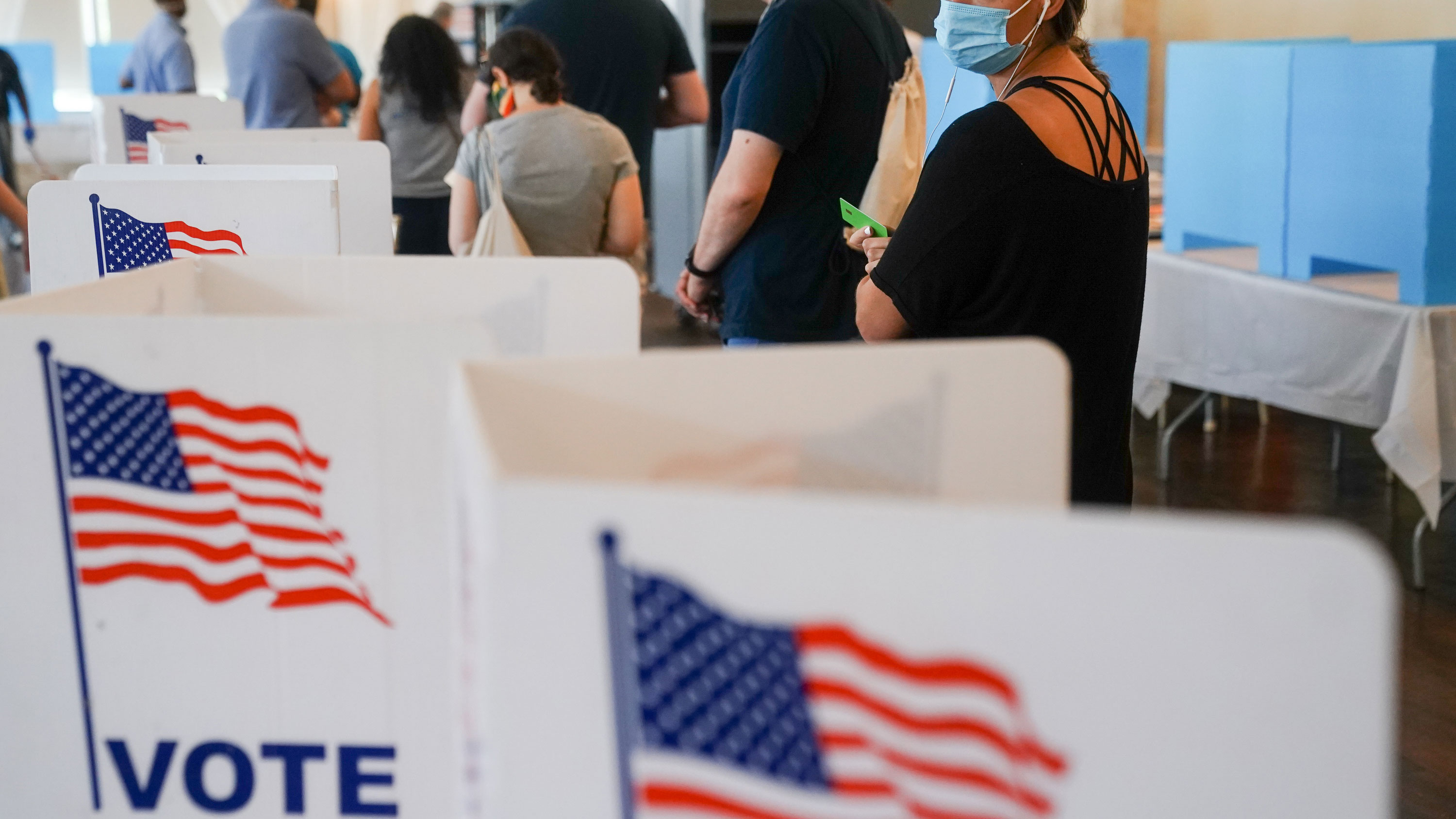 Activists claim fees, postage amount to modern-day poll taxes