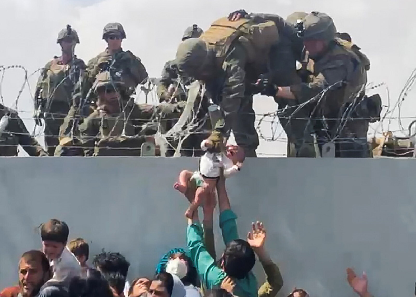 Fact check: Did the Marine who Trump brought on stage at rally actually hoist a baby over a wall at Kabul airport?