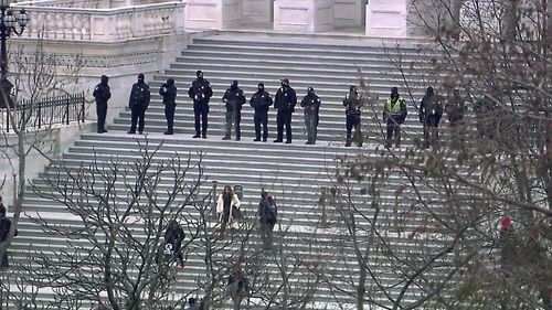 Image for US Capitol secured, 4 dead after rioters stormed the halls of Congress to block Biden's win