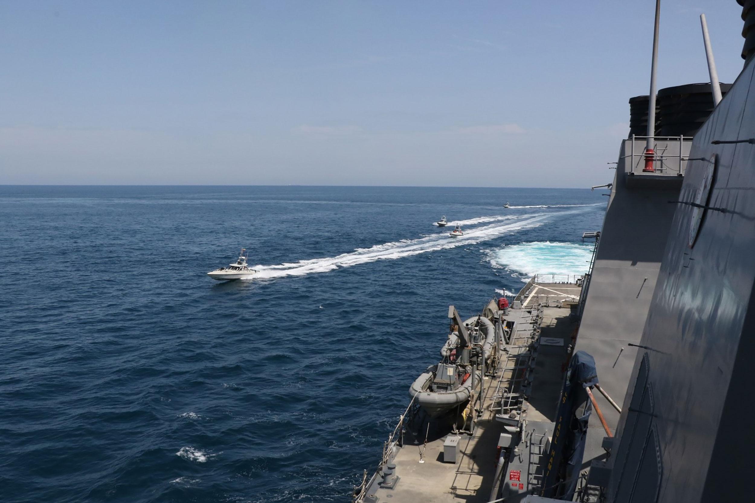 US Coast Guard ship fired around 30 warning shots at Iranian fast boats in latest tense encounter